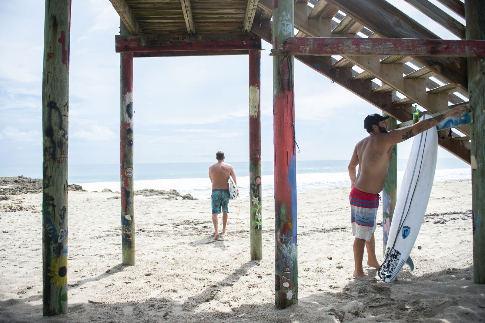 "Brothers Evan Miller, left, and Eric Hicks, both of Stuart, Fla., prepare to catch some waves ahead of Hurricane Dorian on Thursday, Aug. 29, 2019, at Chastain Beach on Hutchinson Island, Fla. ""Sunday or Monday looks like the days (for big waves), as soon as that wind goes into the west,"" Miller said.  (Leah Voss/TCPalm.com via AP)"