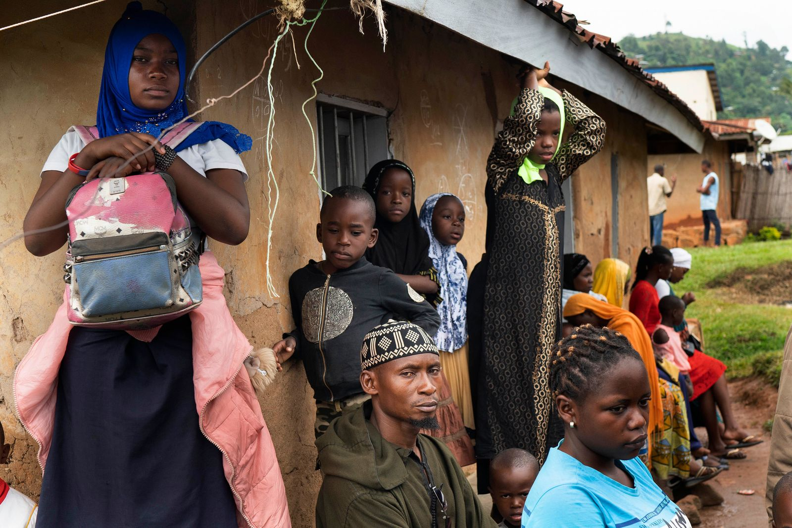 In this photograph taken Saturday July 13, 2019, residents wait in line to receive the Ebola vaccine in Beni, Congo DRC. The head of the World Health Organization is convening a meeting of experts Wednesday July 17, 2019 to decide whether the Ebola outbreak should be declared an international emergency after spreading to eastern Congo's biggest city, Goma, this week. More than 1,600 people in eastern Congo have died as the virus has spread in areas too dangerous for health teams to access. (AP Photo/Jerome Delay)