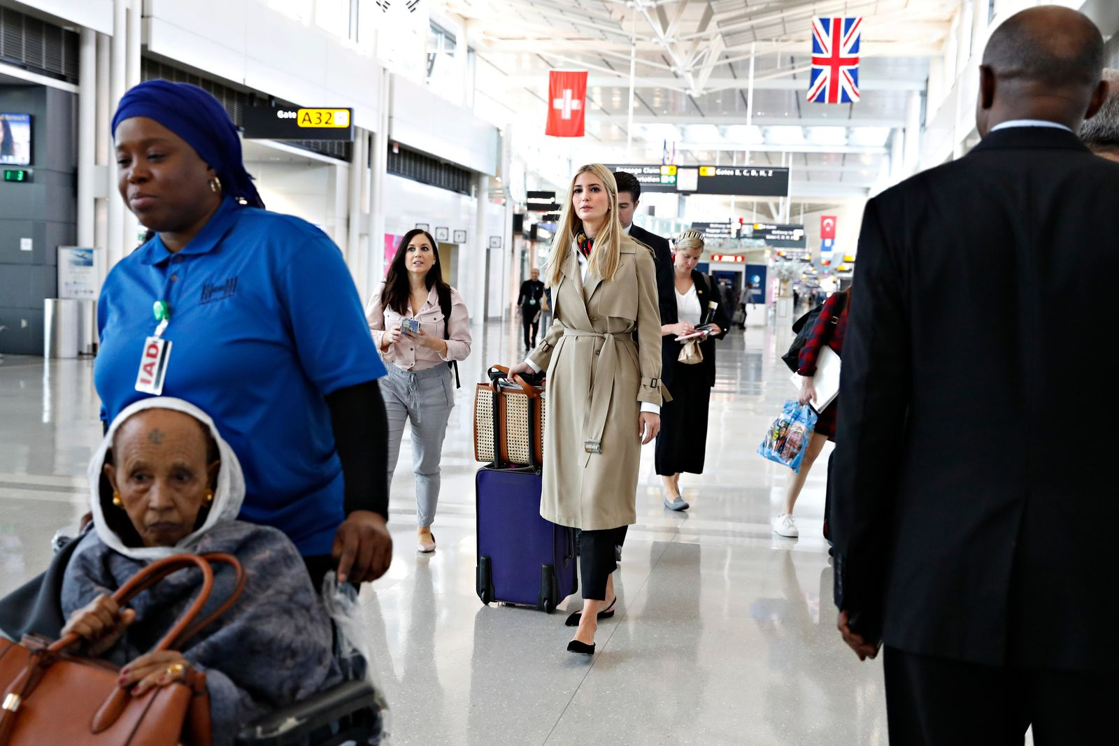 Ivanka Trump, center, walks through a terminal of Dulles International Airport, in Sterling, Va., Saturday April 13, 2019, to board a flight to Ethiopia. (AP Photo/Jacquelyn Martin)