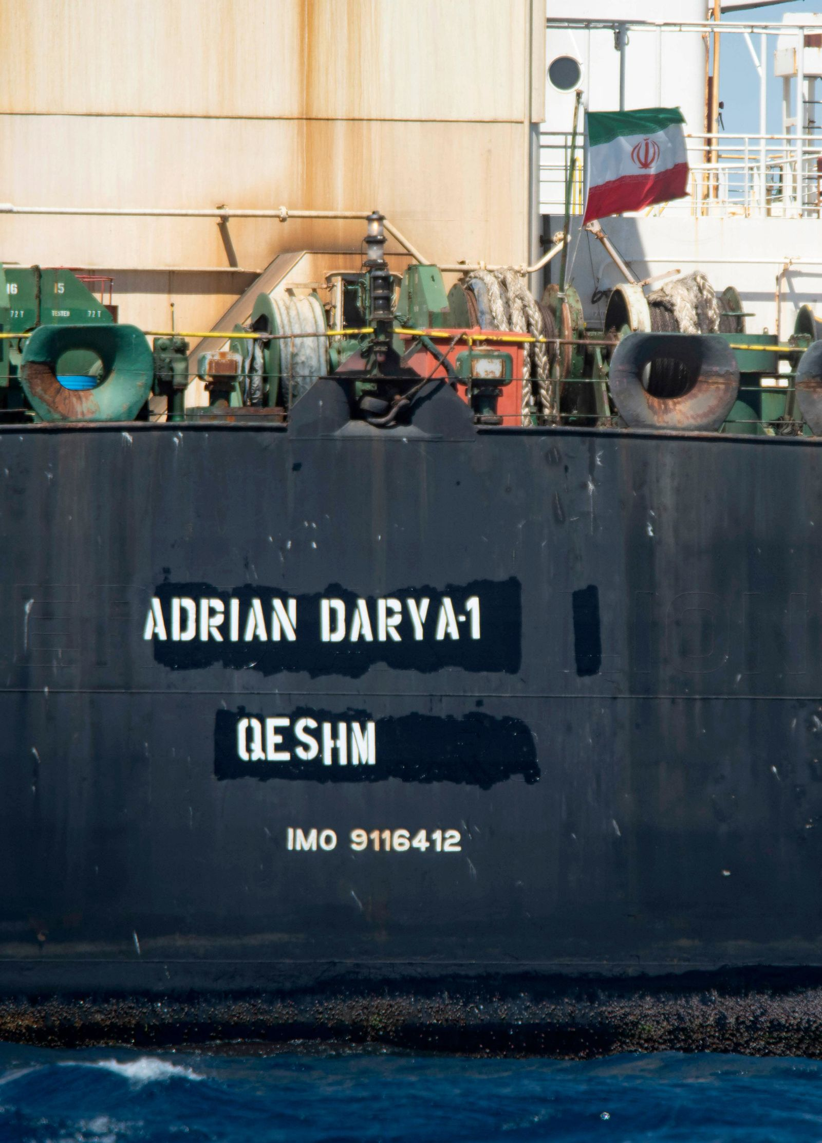 Renamed Adrian Aryra 1 super tanker hosting an Iranian flag, sails in the the waters of the British territory of Gibraltar, Sunday, Aug. 18, 2019. Authorities in Gibraltar on Sunday rejected the United States' latest request not to release a seized Iranian supertanker, clearing the way for the vessel to set sail after being detained last month for allegedly attempting to breach European Union sanctions on Syria. (AP Photo/Marcos Moreno)
