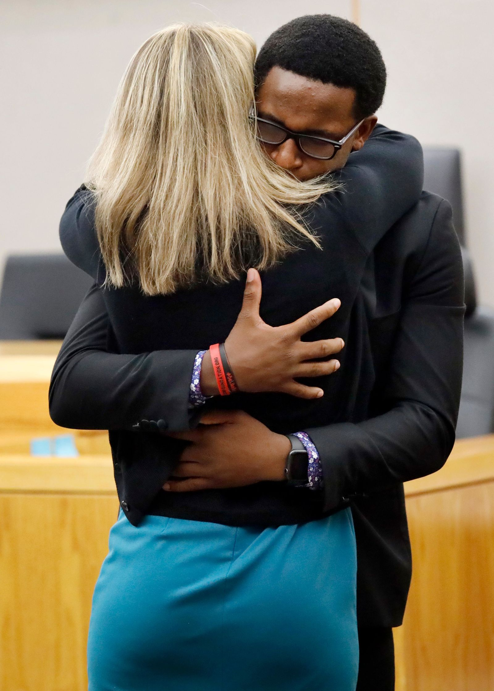 Botham Jean's younger brother Brandt Jean hugs former Dallas police officer Amber Guyger after delivering his impact statement to her in Dallas, Wednesday, Oct. 2, 2019. Guyger has been sentenced to 10 years in prison for killing her black neighbor in his apartment, which she said she mistook for her own unit one floor below. (Tom Fox/The Dallas Morning News via AP, Pool)