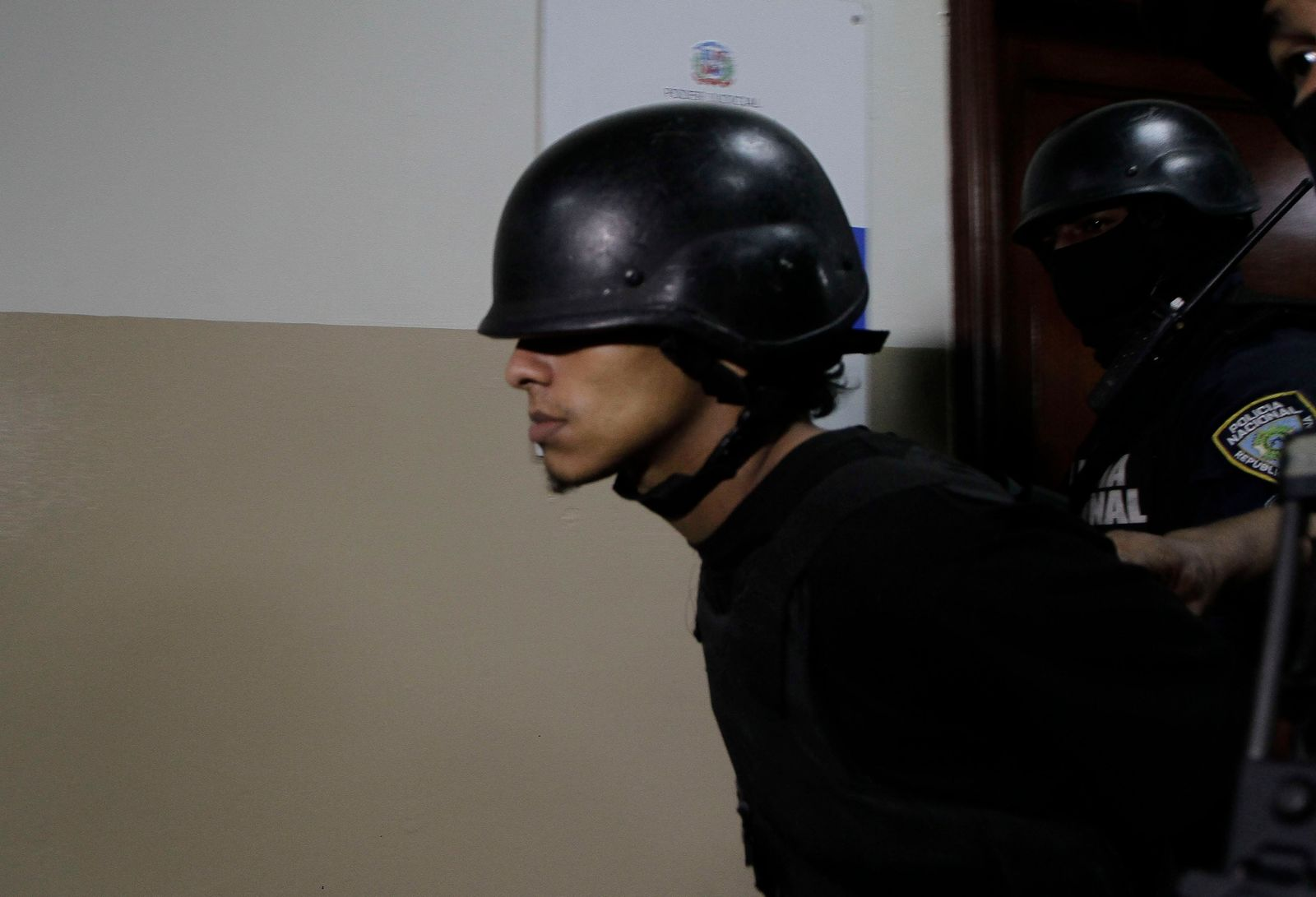 Rolfy Ferreyra Cruz, a suspect in connection with the shooting of former Boston Red Sox slugger David Ortiz, is taken to court by police in Santo Domingo, Dominican Republic, Friday, June 14, 2019.(AP Photo/Roberto Guzman)