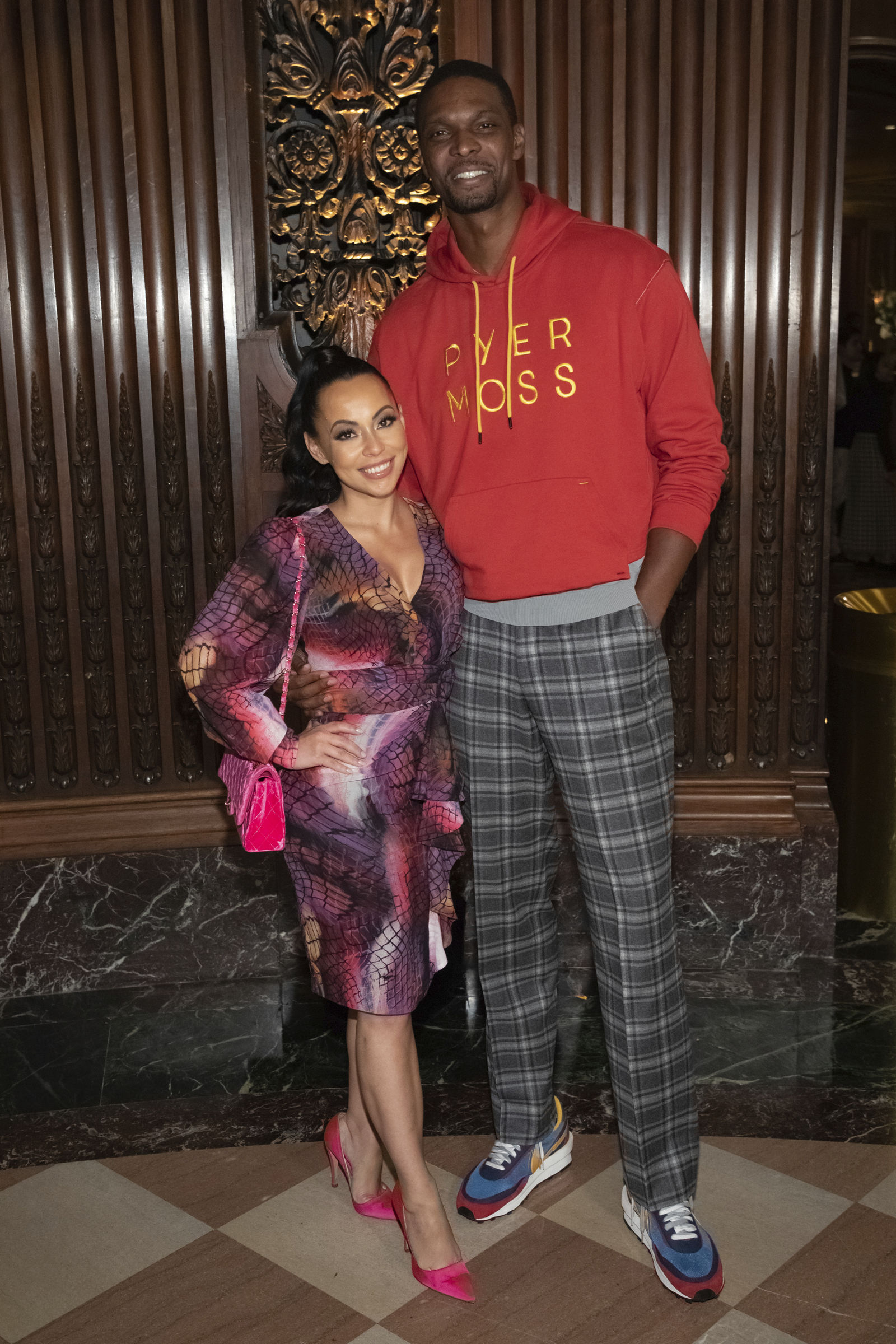 Professional basketball player Chris Bosh and a guest attend the Pyer Moss runway show during NYFW Spring/Summer 2020 on Sunday, Sept. 8, 2019, in Brooklyn, New York. (Photo by Brent N. Clarke/Invision/AP)