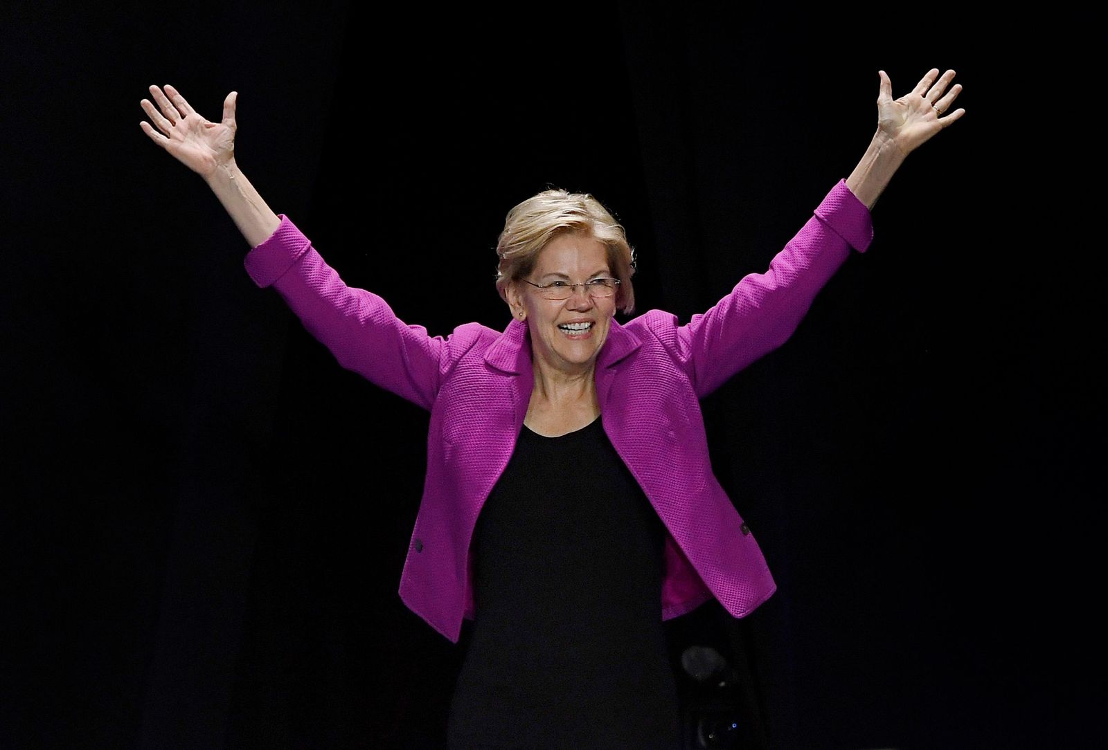 FILE- Democratic presidential candidate U.S. Sen. Elizabeth Warren, gestures toward delegates during the 2019 Massachusetts Democratic Party Convention, Saturday, Sept. 14, 2019, in Springfield, Mass. (AP Photo/Jessica Hill)