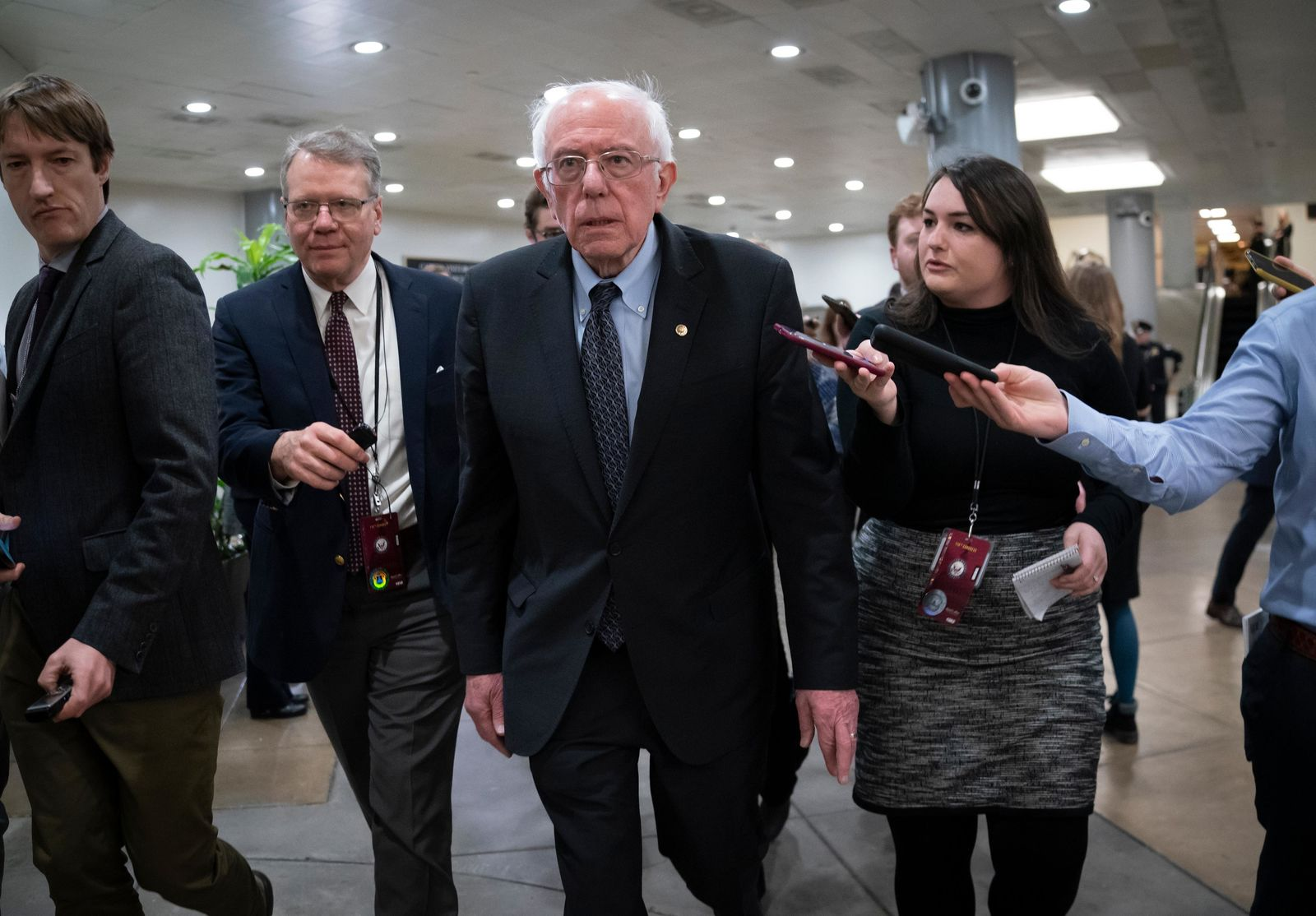 FILE - Democratic presidential candidate, Sen. Bernie Sanders, I-Vt., talks to reporters just after the start of the impeachment trial of President Donald Trump on charges of abuse of power and obstruction of Congress, at the Capitol in Washington, Thursday, Jan. 16, 2020. (AP Photo/J. Scott Applewhite)