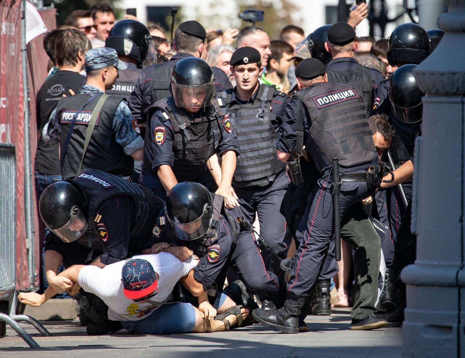 FILE - In this file photo taken on Saturday, July 27, 2019, police officers detain protesters during an unsanctioned rally in the center of Moscow, Russia.{ } (AP Photo/Alexander Zemlianichenko, File)