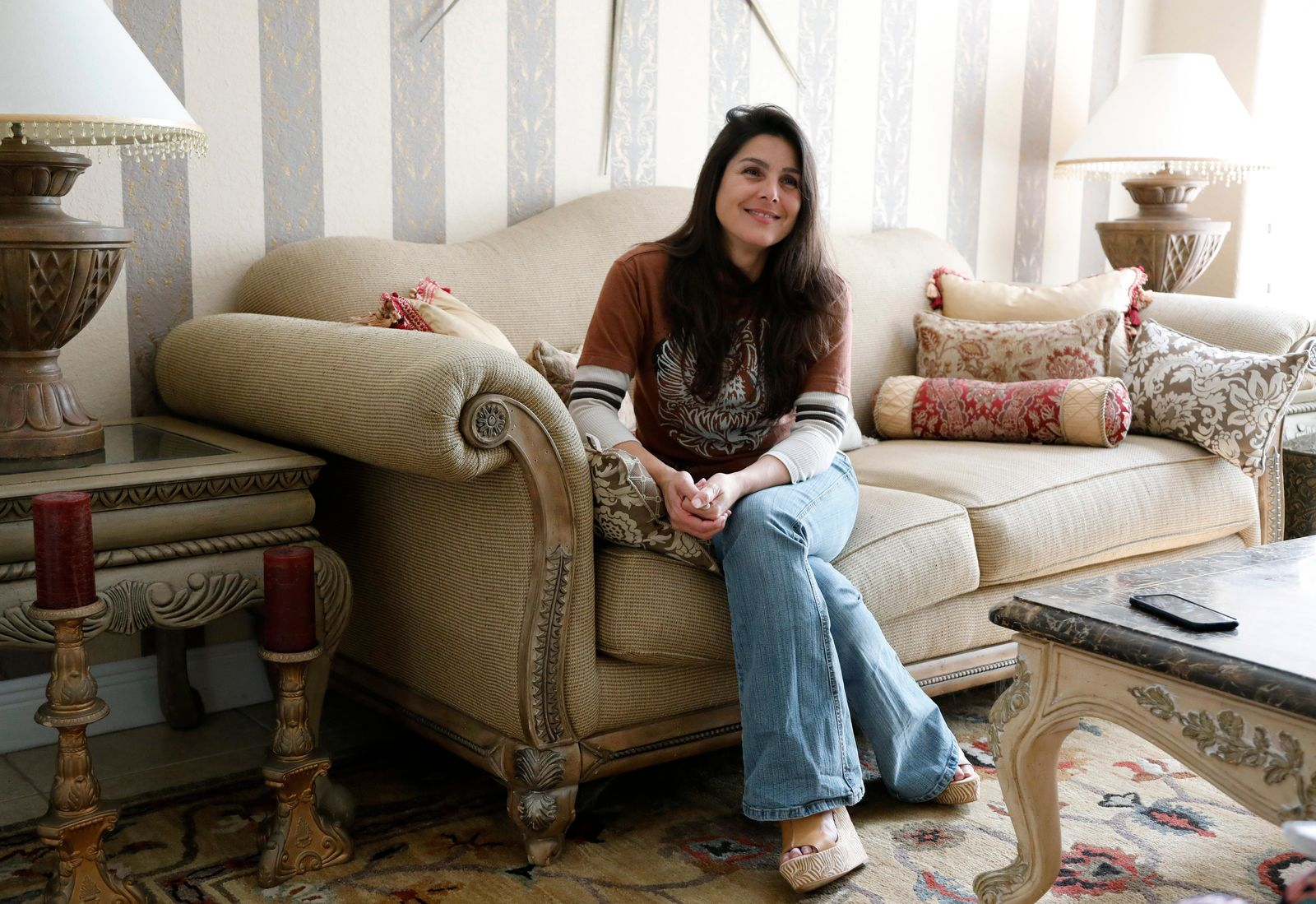 Judith Negron is interviewed at her home in Hialeah, Fla., Wednesday, Feb. 19, 2020. Negron was serving 35 years at a Florida prison for health care fraud, conspiracy and money laundering when she was released Tuesday after President Donald Trump commuted her sentence. (AP Photo/Terry Renna)