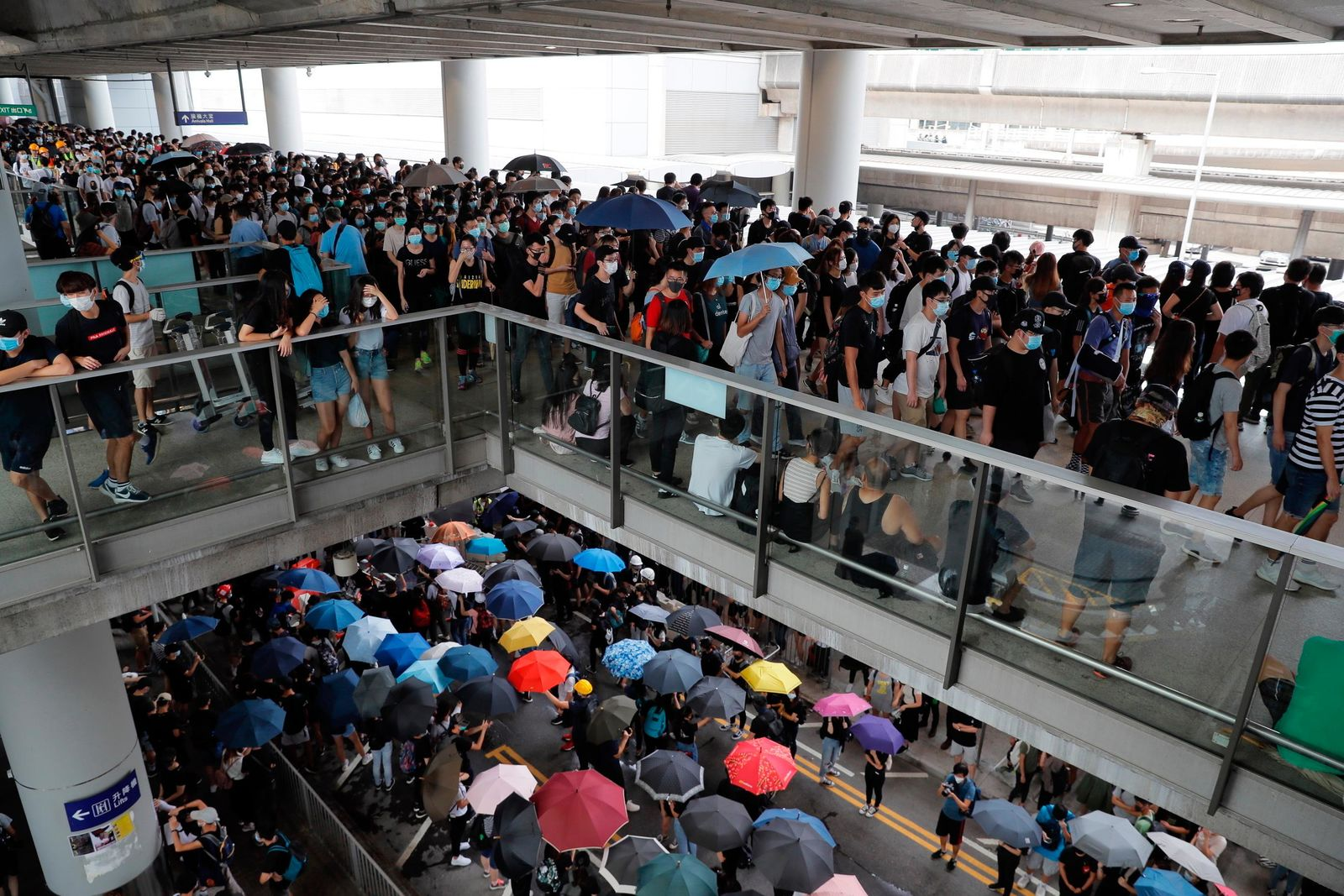 Pro-democracy protestors gather outside the airport in, Hong Kong, Sunday, Sept.1, 2019.{ } (AP Photo/Kin Cheung)