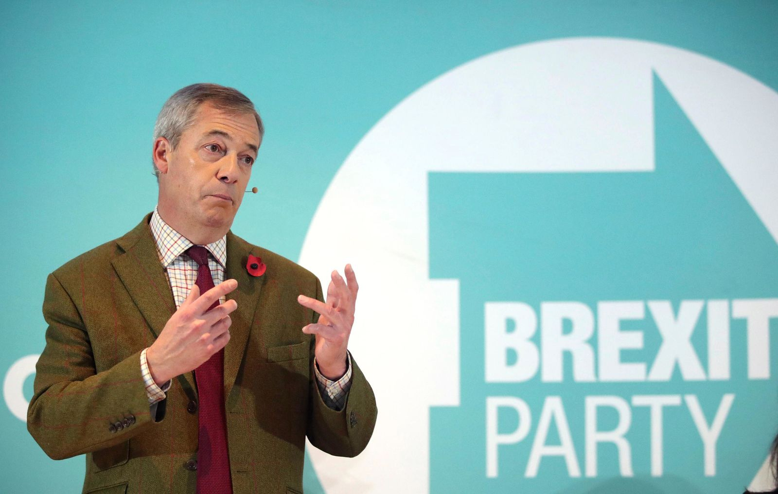 Brexit Party leader Nigel Farage gestures as he delivers a speech to supporters, during an event at the Washington Central Hotel, in Workington, England, Wednesday, Nov. 6, 2019.{ } (Danny Lawson/PA via AP)
