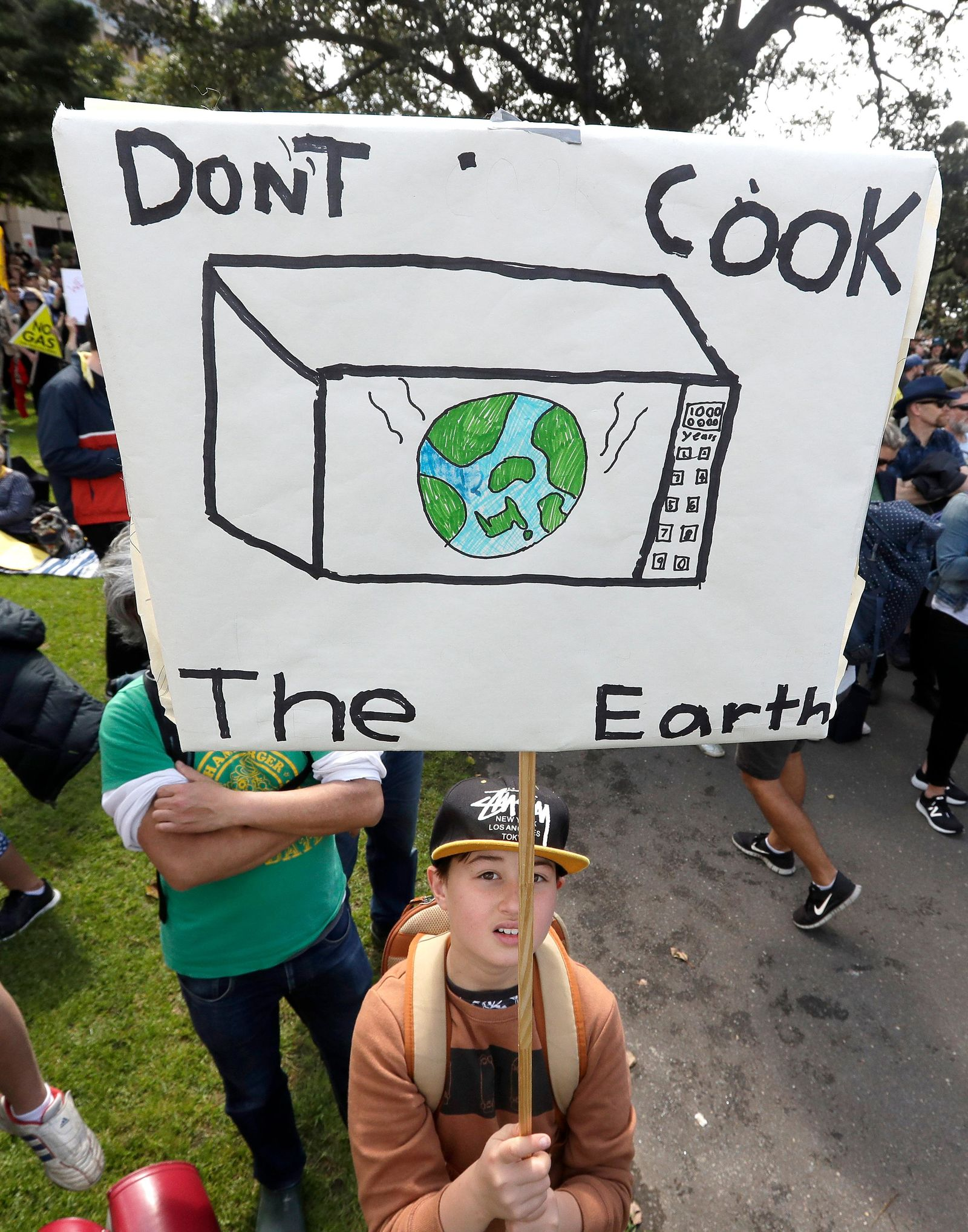 "A young activist holds up a handmade placard as thousands of protestors, many of them school students, gather in Sydney, Friday, Sept. 20, 2019, calling for action to guard against climate change. Australia's acting Prime Minister Michael McCormack has described ongoing climate rallies as ""just a disruption"" that should have been held on a weekend to avoid inconveniencing communities. (AP Photo/Rick Rycroft)"