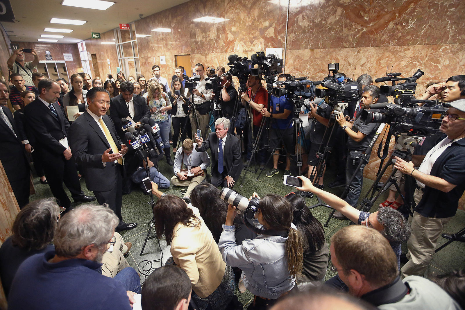 FILE - In this July 7, 2015, file photo, San Francisco Public Defender Jeff Adachi, left, talks to members of the media after Francisco Sanchez' arraignment in San Francisco.{ } (AP Photo/Tony Avelar, File)