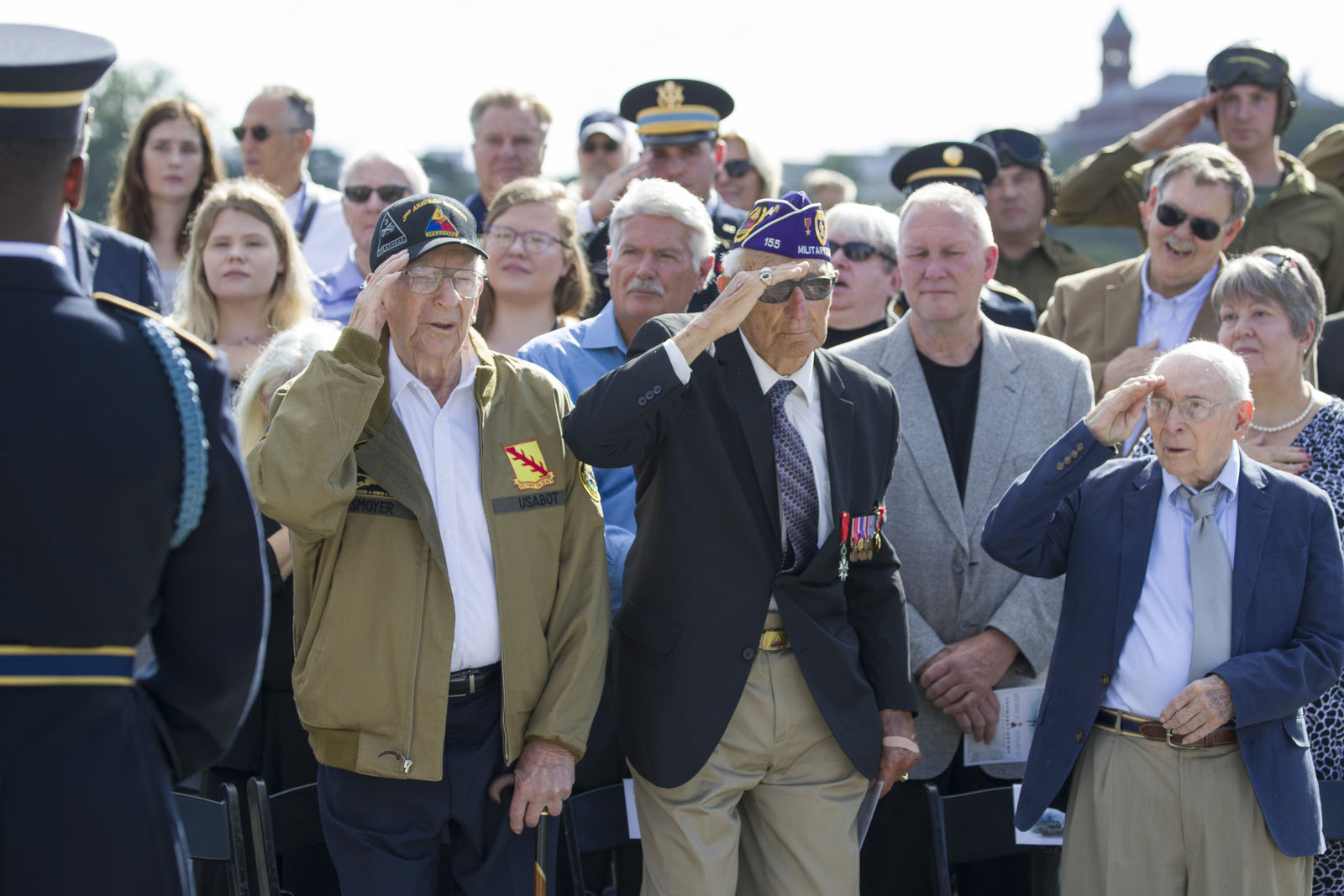 World War II veterans Clarence Smoyer, 96, left, Joseph Caserta and Buck Marsh salute during a ceremony to present the Bronze Star to Smoyer at the World War II Memorial, Wednesday, Sept. 18, 2019, in Washington. Smoyer fought with the U.S. Army's 3rd Armored Division, nicknamed the Spearhead Division. In 1945, he defeated a German Panther tank near the cathedral in Cologne, Germany — a dramatic duel filmed by an Army cameraman that was seen all over the world. (AP Photo/Alex Brandon)