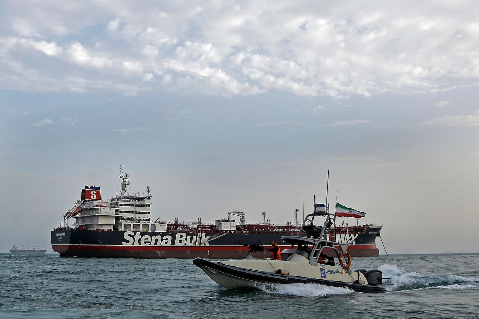 A speedboat of the Iran's Revolutionary Guard moves around a British-flagged oil tanker Stena Impero, which was seized on Friday by the Guard, in the Iranian port of Bandar Abbas, Sunday, July 21, 2019.{ } (Hasan Shirvani/Mizan News Agency via AP)