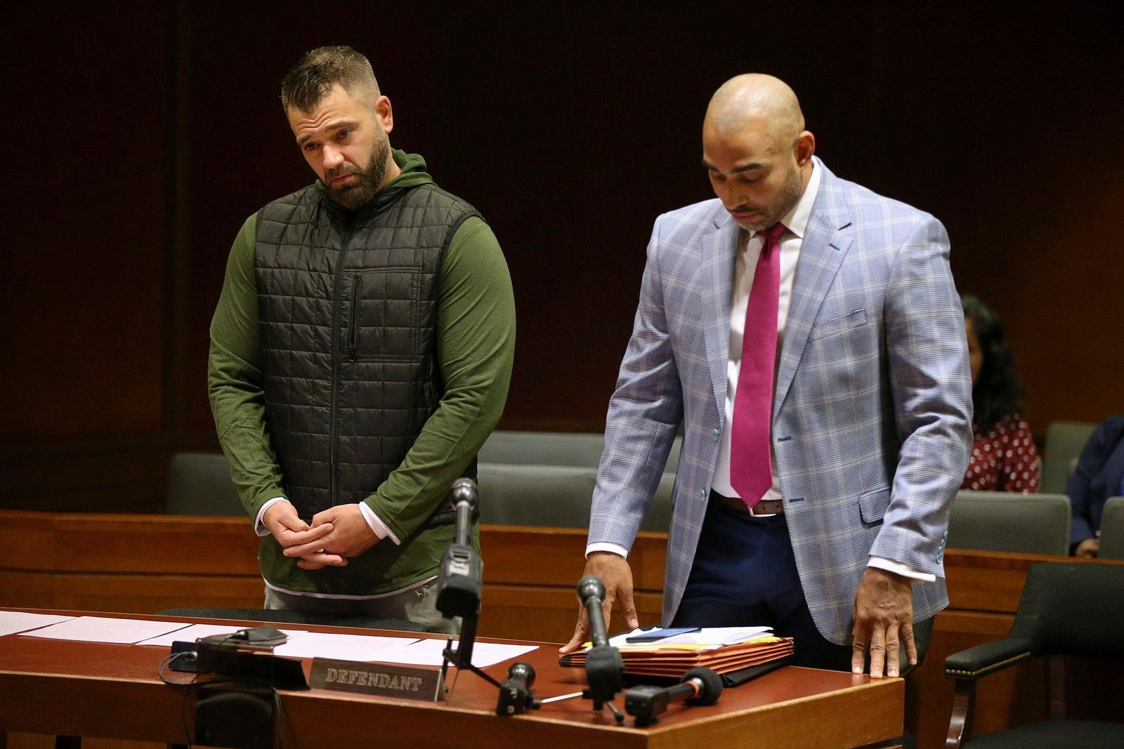 Mark D'Amico, left, stands with his lawyer, Mark Davis, as he pleads guilty to one count of misappropriating entrusted funds in Burlington County Superior Court in Mount Holly, N.J., on Friday, Dec. 6, 2019.{ } (Tim Tai/The Philadelphia Inquirer via AP)