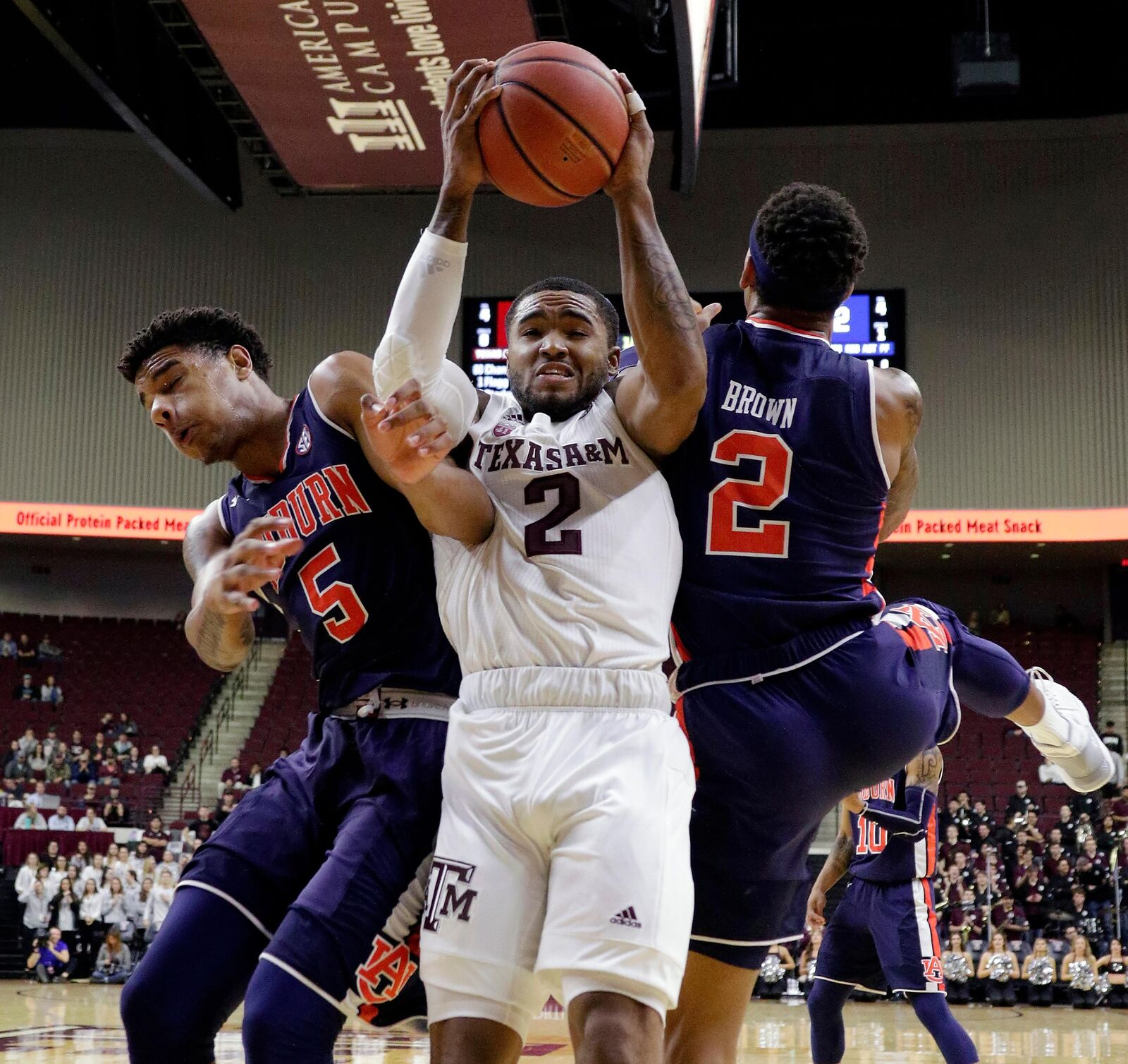 Texas A&M guard TJ Starks (2) is defended on a rebound between Auburn forward Chuma Okeke (5) and guard Bryce Brown (2) during the first half of an NCAA college basketball game, Wednesday, Jan. 16, 2019, in College Station, Texas. (AP Photo/Michael Wyke)