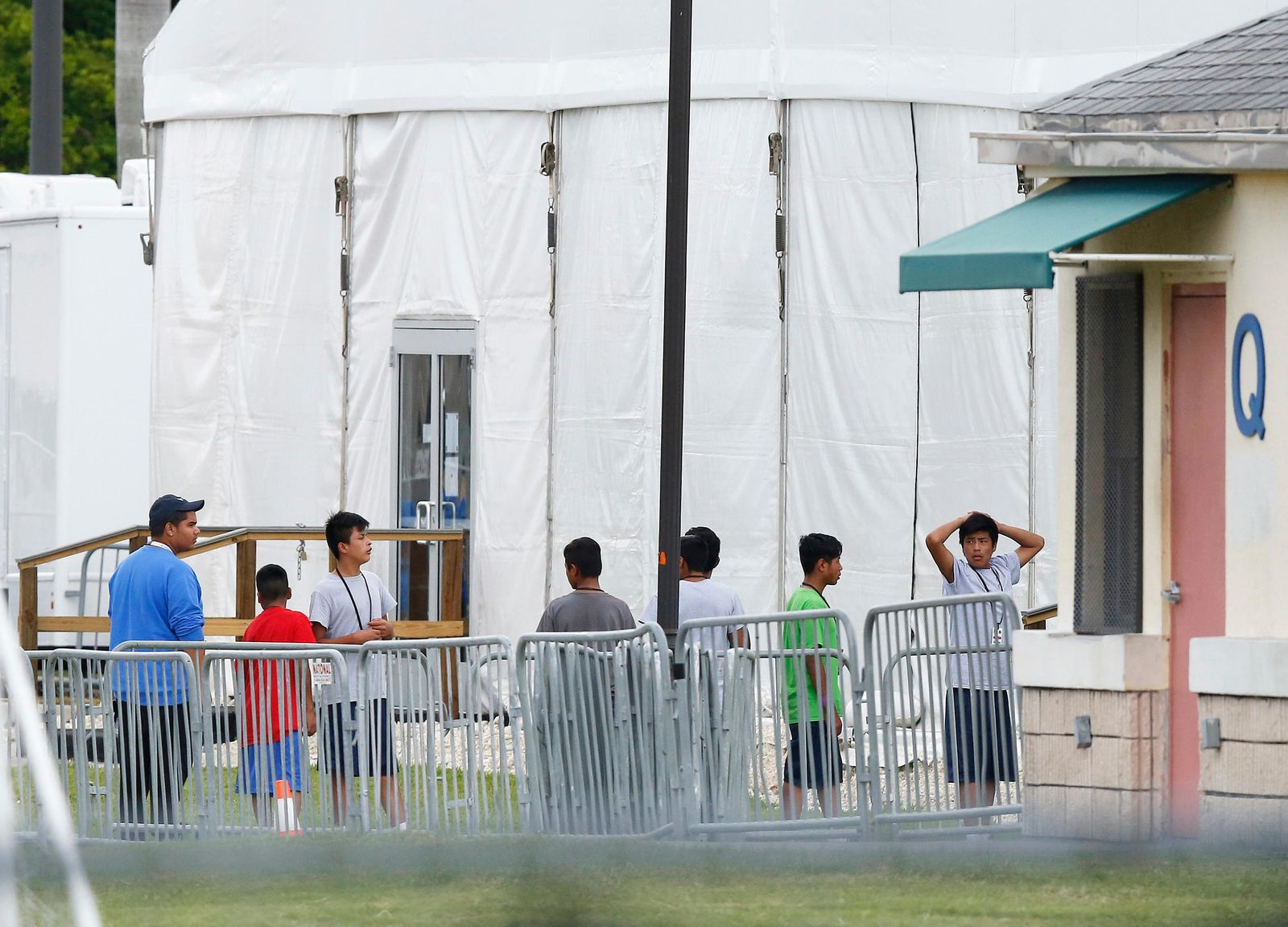 FILE - In this June 20, 2018, file photo, immigrant children walk in a line outside the Homestead Temporary Shelter for Unaccompanied Children, a former Job Corps site that now houses them in Homestead, Fla. (AP Photo/Brynn Anderson, File)