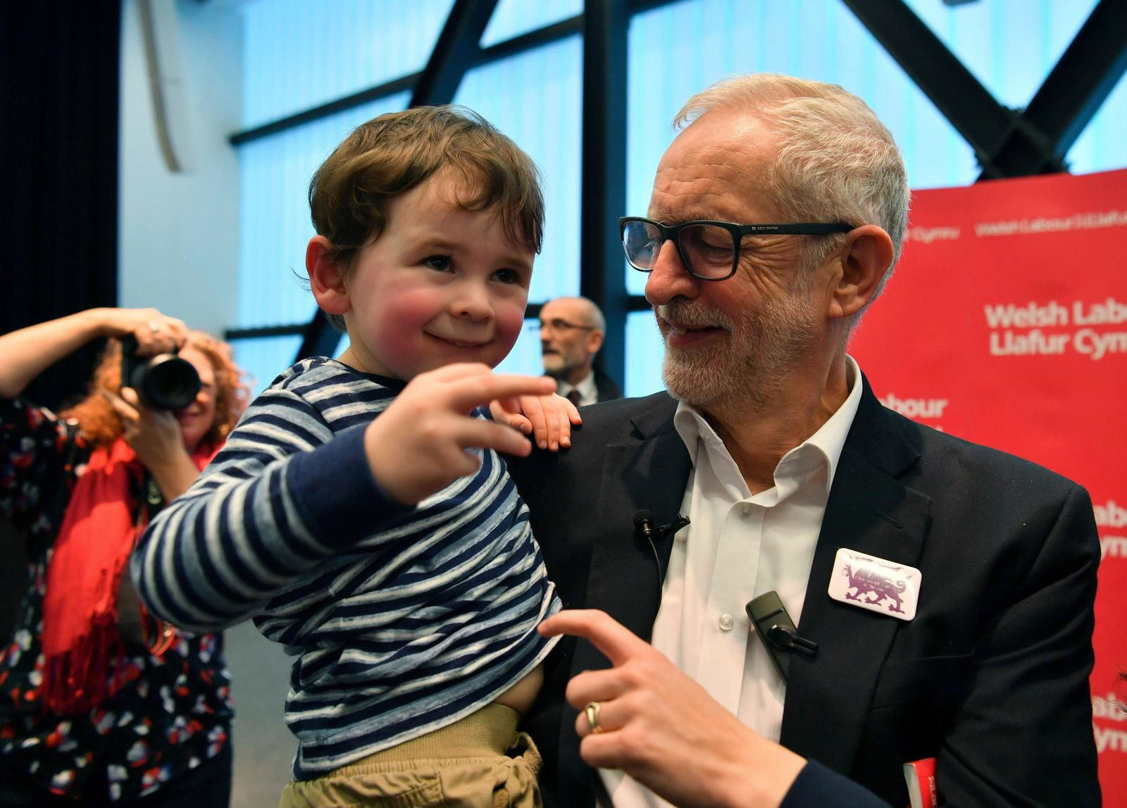 Labour Leader Jeremy Corbyn interacts with three years old Noa Williams Roberts after addressing a members' rally at Bangor University, while on the General Election campaign trail in Bangor, Wales, Sunday, Dec. 8, 2019. (Ben Birchall/PA via AP)