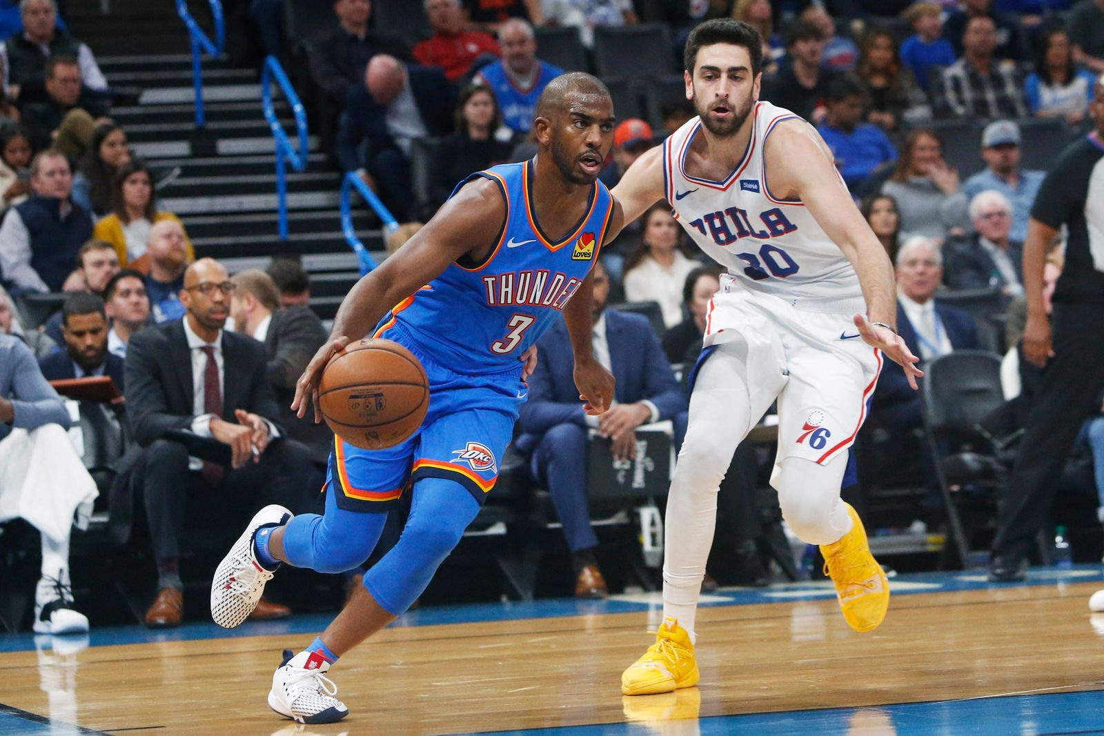 Oklahoma City Thunder guard Chris Paul (3) drives around Philadelphia 76ers guard Furkan Korkmaz (30) during the first half of an NBA basketball game Friday, Nov. 15, 2019, in Oklahoma City. (AP Photo/Sue Ogrocki)
