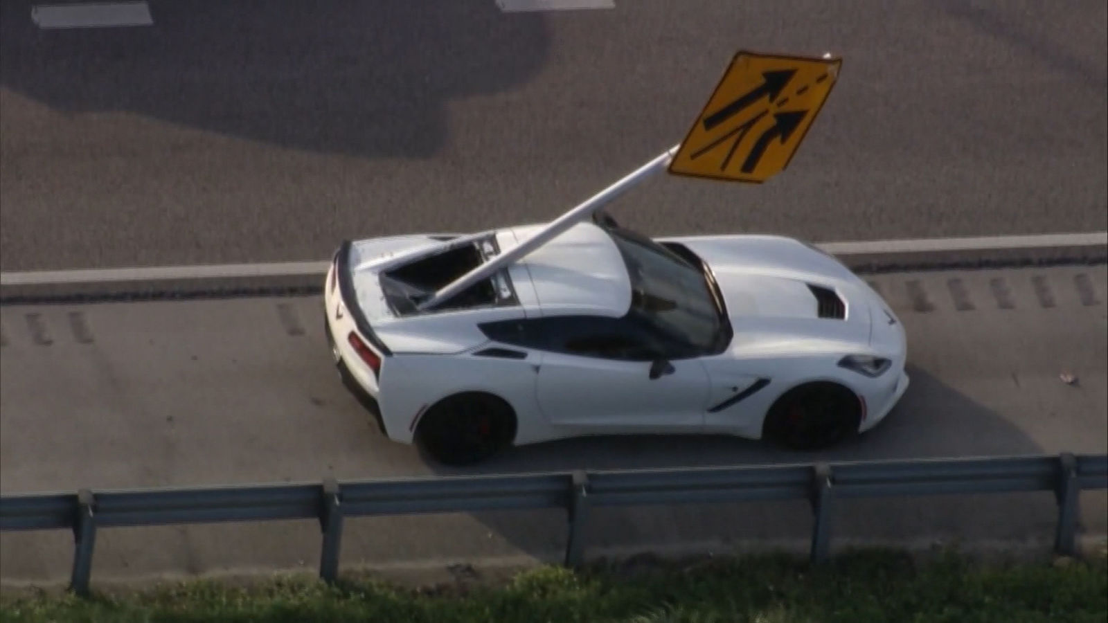 corvette impaled by street sign during multi