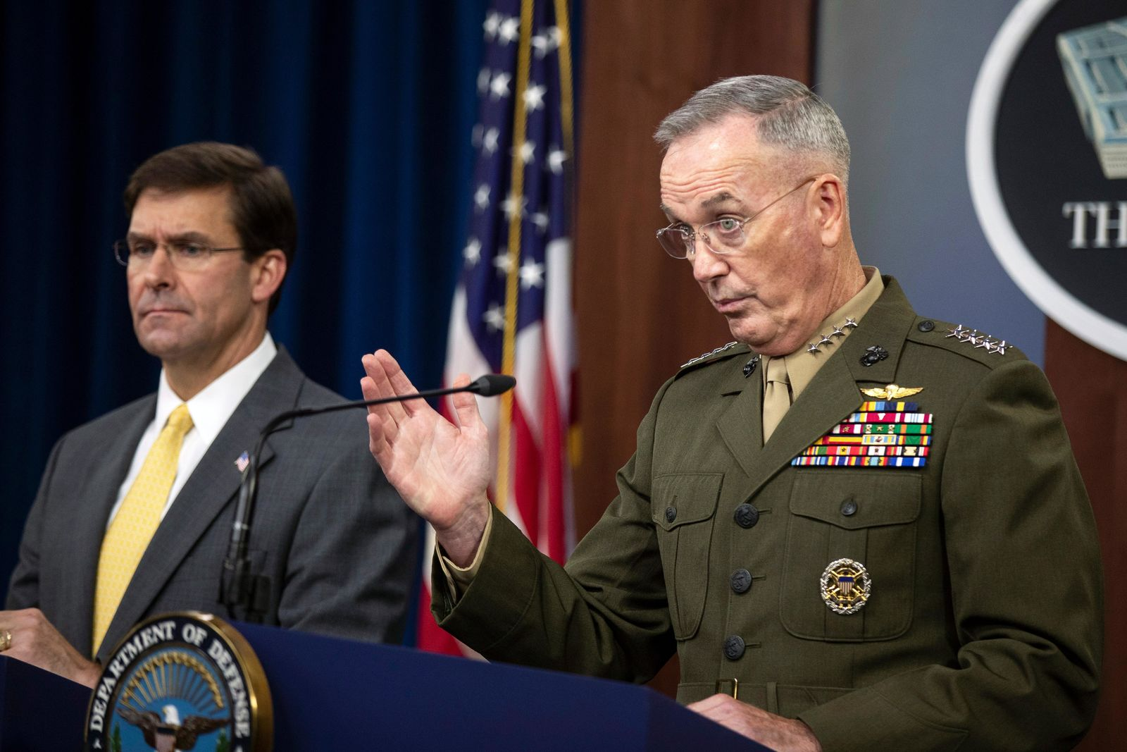 Joint Chiefs Chairman Gen. Joseph Dunford with Secretary of Defense Mark Esper speaks to reporters during a briefing at the Pentagon, Wednesday, Aug. 28, 2019. (AP Photo/Manuel Balce Ceneta)