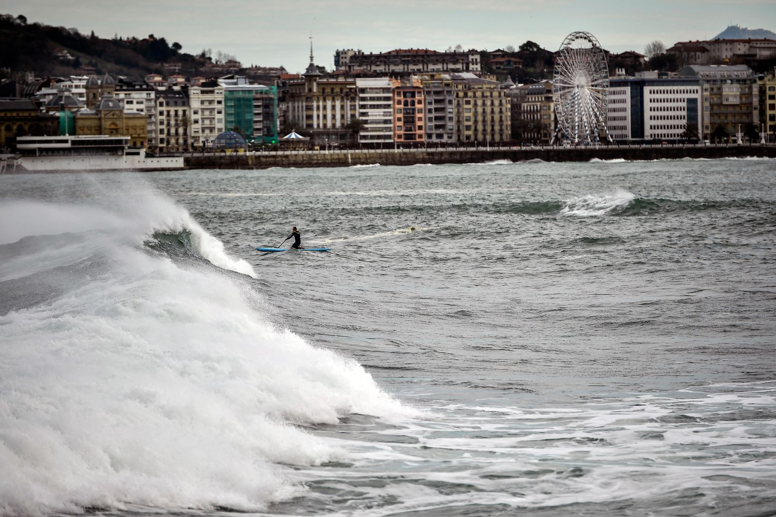 A giant wave crashes in front of the La Concha beach, during a high tide in San Sebastian, northern Spain, Sunday, Dec. 22, 2019.{ } (AP Photo/Alvaro Barrientos)