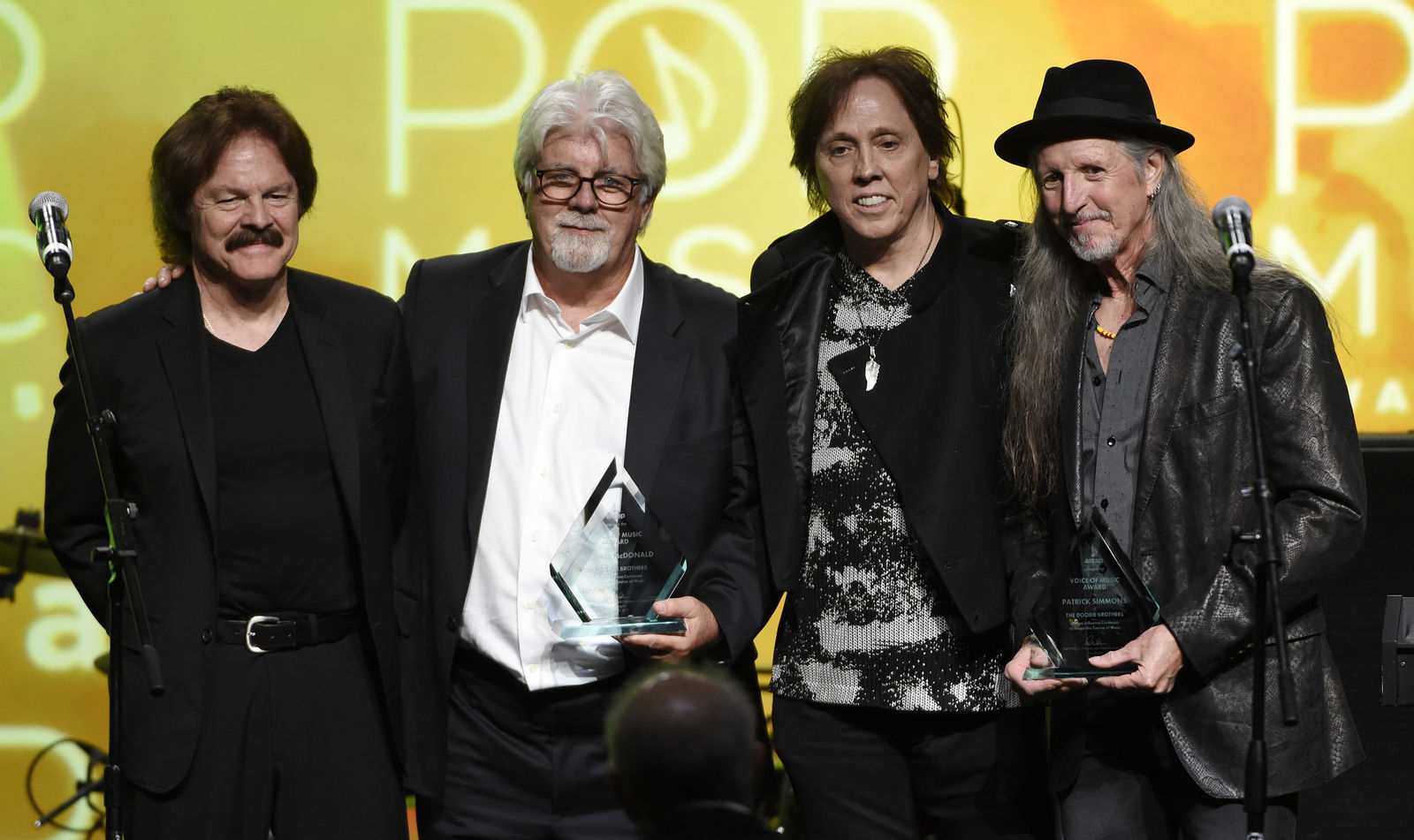 FILE - This April 29, 2015 file photo shows , from left, Tom Johnston, Michael McDonald, John McFee and Pat Simmons of the band the Doobie Brothers onstage after receiving the ASCAP Voice of Music Award at the 32nd Annual ASCAP Pop Music Awards in Los Angeles. The Doobie Brothers are among the 16 acts nominated for the Rock and Roll Hall of Fame's 2020 class. (Photo by Chris Pizzello/Invision/AP, File)