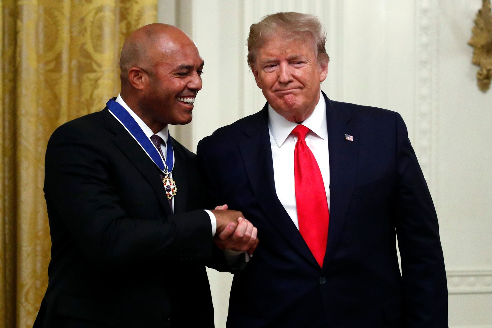 President Donald Trump presents the Presidential Medal of Freedom to former New York Yankees baseball pitcher Mariano Rivera, in the East Room of the White House, Monday, Sept. 16, 2019, in Washington. (AP Photo/Patrick Semansky)