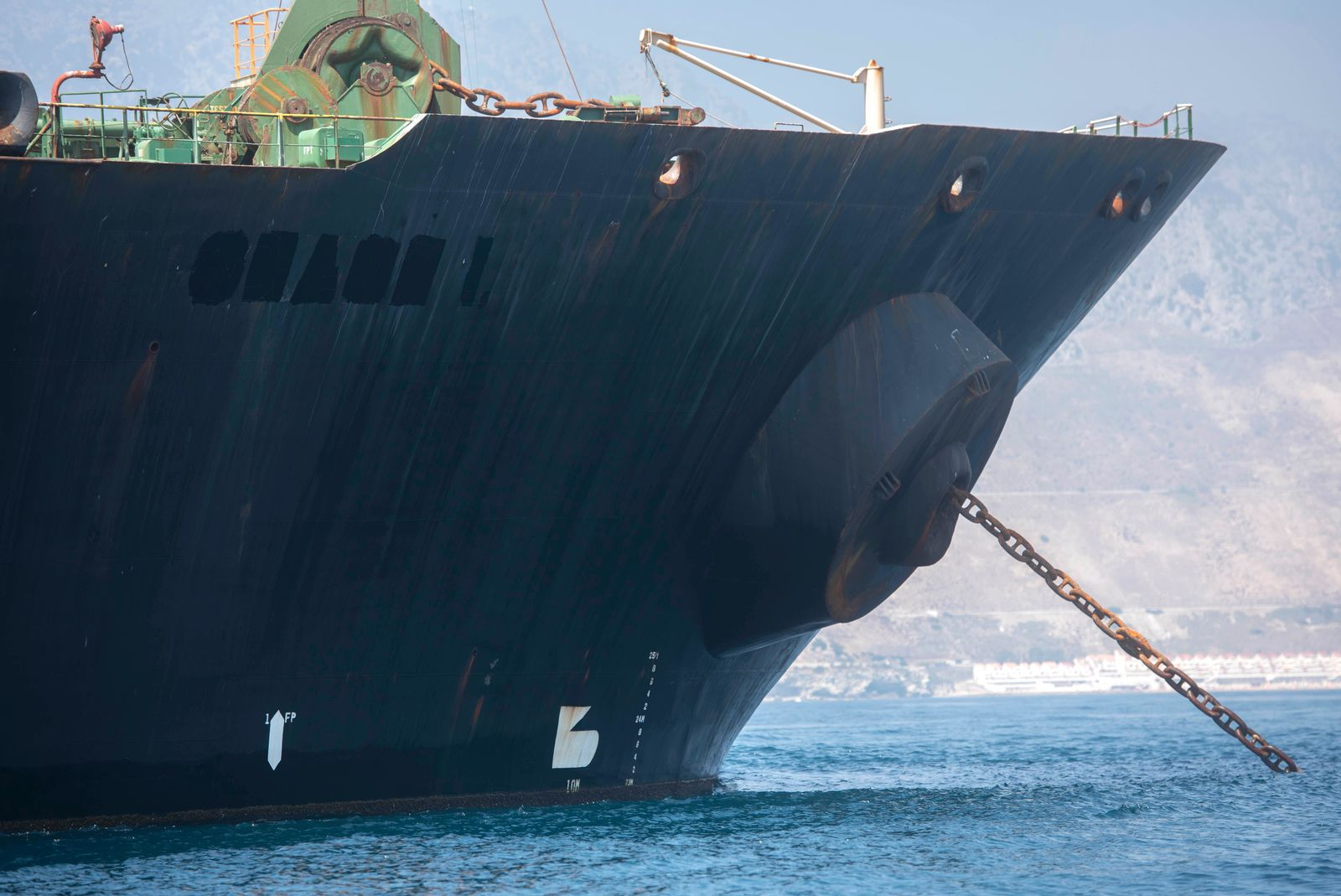 A view of the Grace 1 super tanker with the name removed is seen in the British territory of Gibraltar, Saturday, Aug. 17, 2019. (AP Photo/Marcos Moreno)