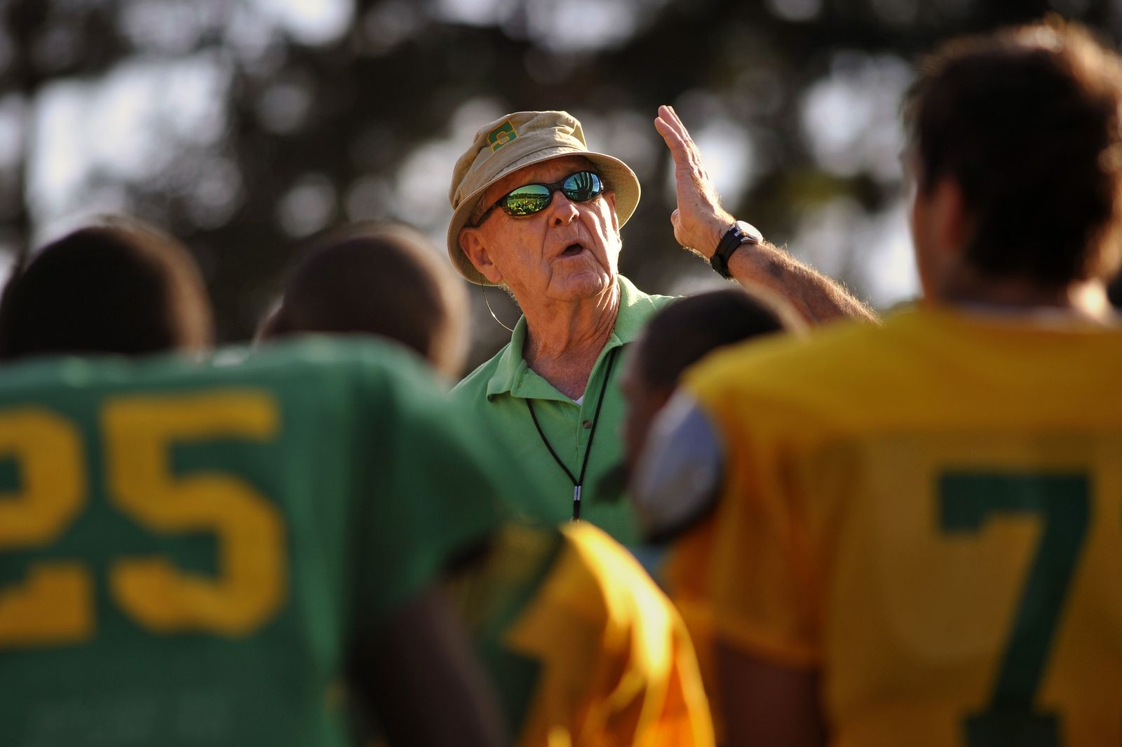 FILE - In this Oct. 24, 2012, file photo, Summerville High School coach John McKissick coaches his team during practice in Summerville, S.C. McKissick, whose 621 victories at South Carolina's Summerville High made him the nation's winningest football coach at any level, has died at age 93. Dorchester County Coroner Paul Brouthers said McKissick had been in hospice care and died Thursday, Nov. 28, 2019, surrounded by family. (AP Photo/Stephen Morton, File)