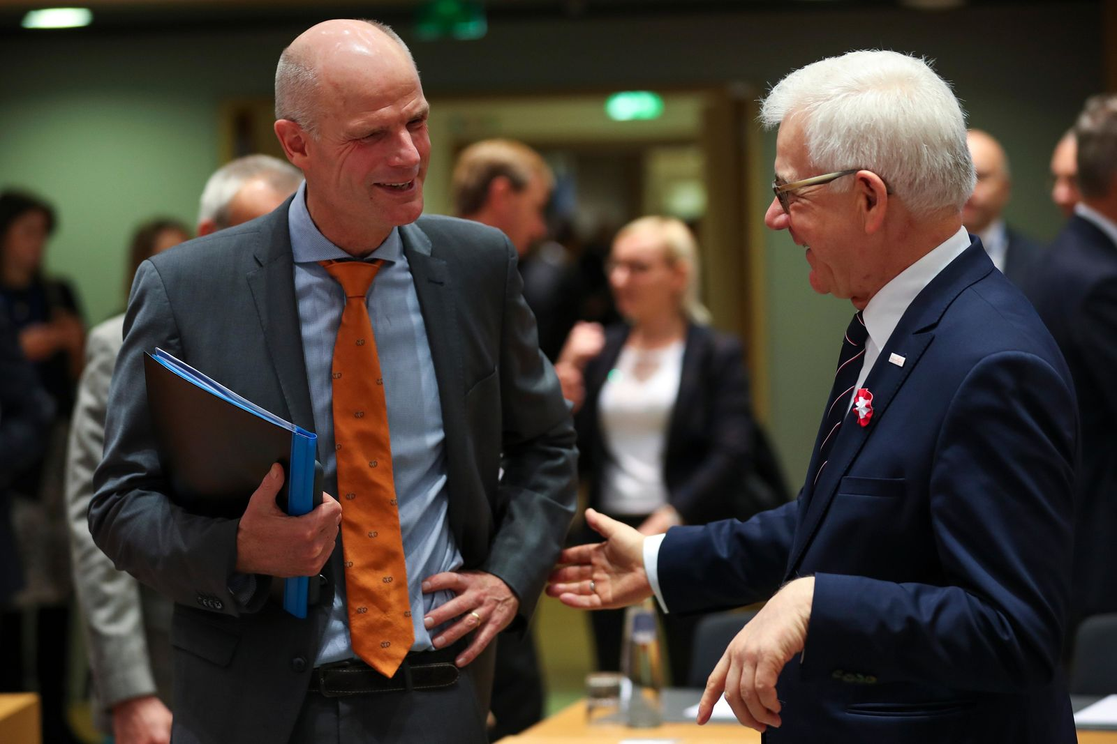 Dutch Foreign Minister Stef Blok, left, talks to Polish Foreign Minister Jacek Czaputowicz during an European Foreign Affairs Ministers meeting at the Europa building in Brussels, Monday, Nov. 11, 2019. (AP Photo/Francisco Seco)