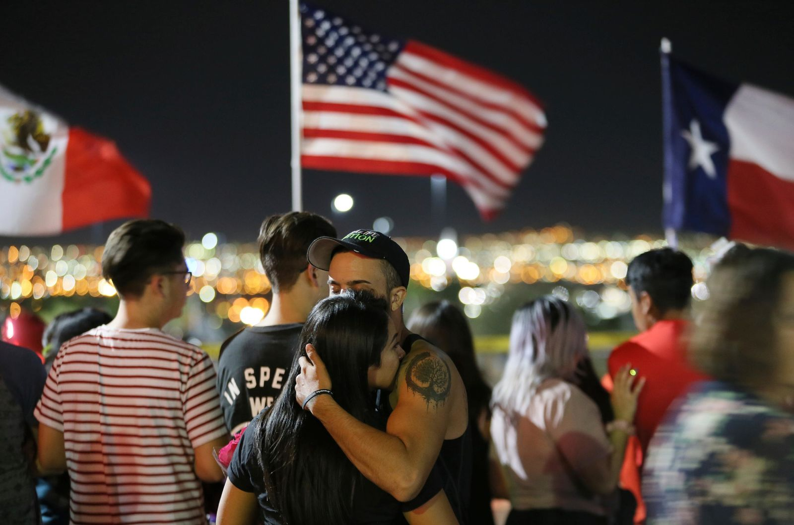 People visit the memorial outside Walmart in El Paso, Texas, where a mass shooting took place on Saturday, Monday, Aug. 5, 2019. (Mark Lambie/The El Paso Times via AP)
