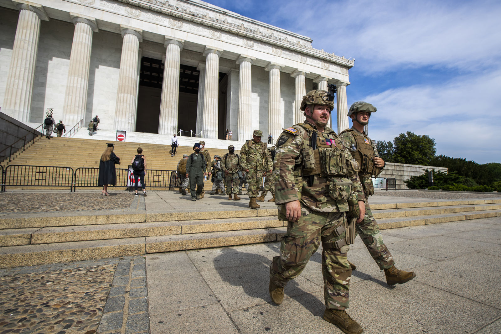 Members of the District of Columbia Army National Guard walk to their designated positions at the National Mall near the Lincoln Memorial in Washington, Wednesday, June 3, 2020, securing the area as protests continue following the death of George Floyd, a who died after being restrained by Minneapolis police officers. (AP Photo/Manuel Balce Ceneta)