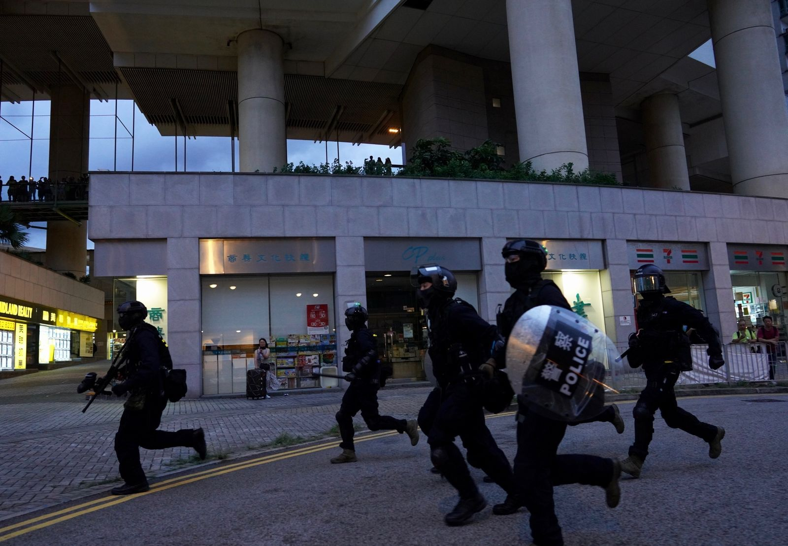 Policemen arrive to arrest protesters at Tung Chung near airport in Hong Kong, Sunday, Sept.1, 2019.{ } (AP Photo/Vincent Yu)