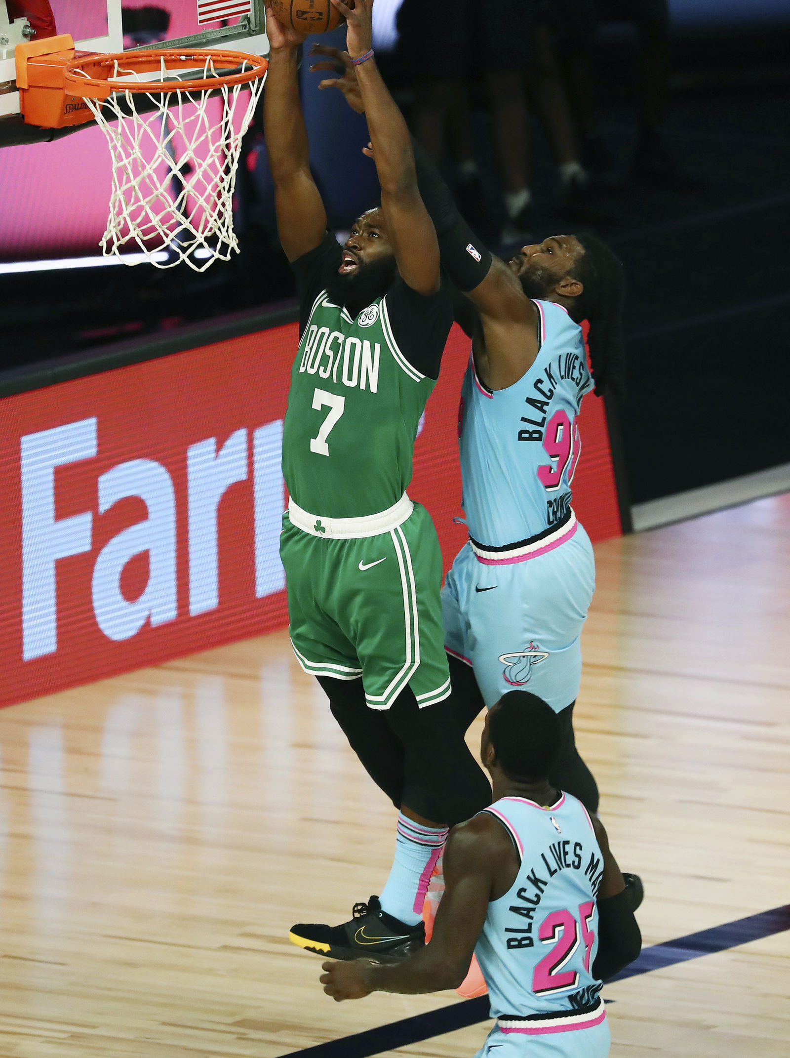 Boston Celtics guard Jaylen Brown (7) dunks against Miami Heat forward Jae Crowder (99) during the second half of an NBA basketball game Tuesday, Aug. 4, 2020, in Lake Buena Vista, Fla. (Kim Klement/Pool Photo via AP)