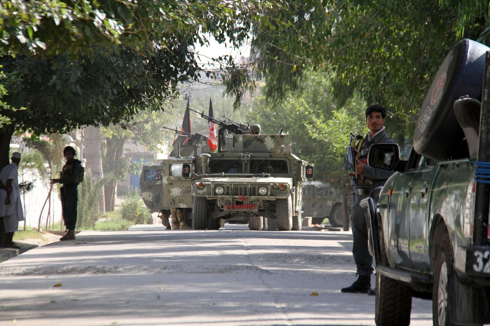 Afghan security forces arrive near the site of a suicide bombing and gun battle as militants attempted to storm a government office, in Jalalabad, the provincial capital of eastern Afghanistan, Wednesday, Sept. 18, 2019. The violence comes as Afghanistan prepares for presidential elections on Sept. 28, a vote the Taliban vehemently oppose. (AP Photo)
