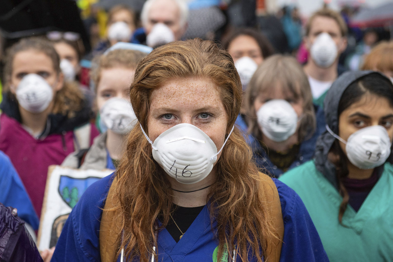 Doctors gather to protest in support of Extinction Rebellion (XR) at Jubilee Gardens, London, Saturday Oct. 12, 2019, to highlight deaths caused by air pollution. (Dominic Lipinski/PA via AP)
