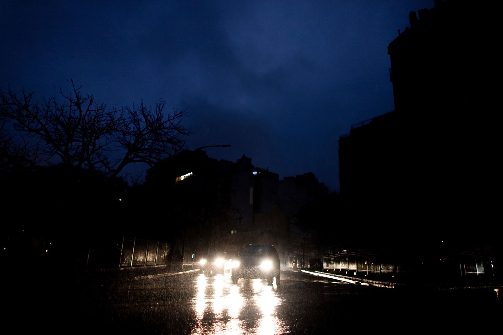 "Cars drive through an unlit street during a blackout in Buenos Aires, Argentina, Sunday, June. 16, 2019. A massive blackout left tens of millions of people without electricity in Argentina, Uruguay and Paraguay on Sunday in what the Argentine president called an ""unprecedented"" failure in the countries' power grid. (AP Photo/Tomas F. Cuesta)"
