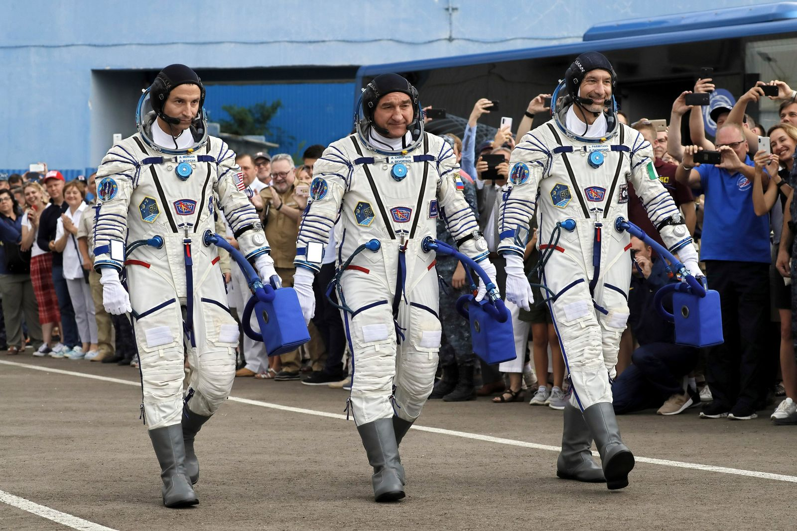 From left: U.S. astronaut Andrew Morgan, Russian cosmonaut Alexander Skvortsov and Italian astronaut Luca Parmitano, members of the main crew of the expedition to the International Space Station (ISS), walk prior the launch of Soyuz MS-13 space ship at the Russian leased Baikonur cosmodrome, Kazakhstan, Saturday, July 20, 2019. (AP Photo/Yuri Kochetkov, Pool)