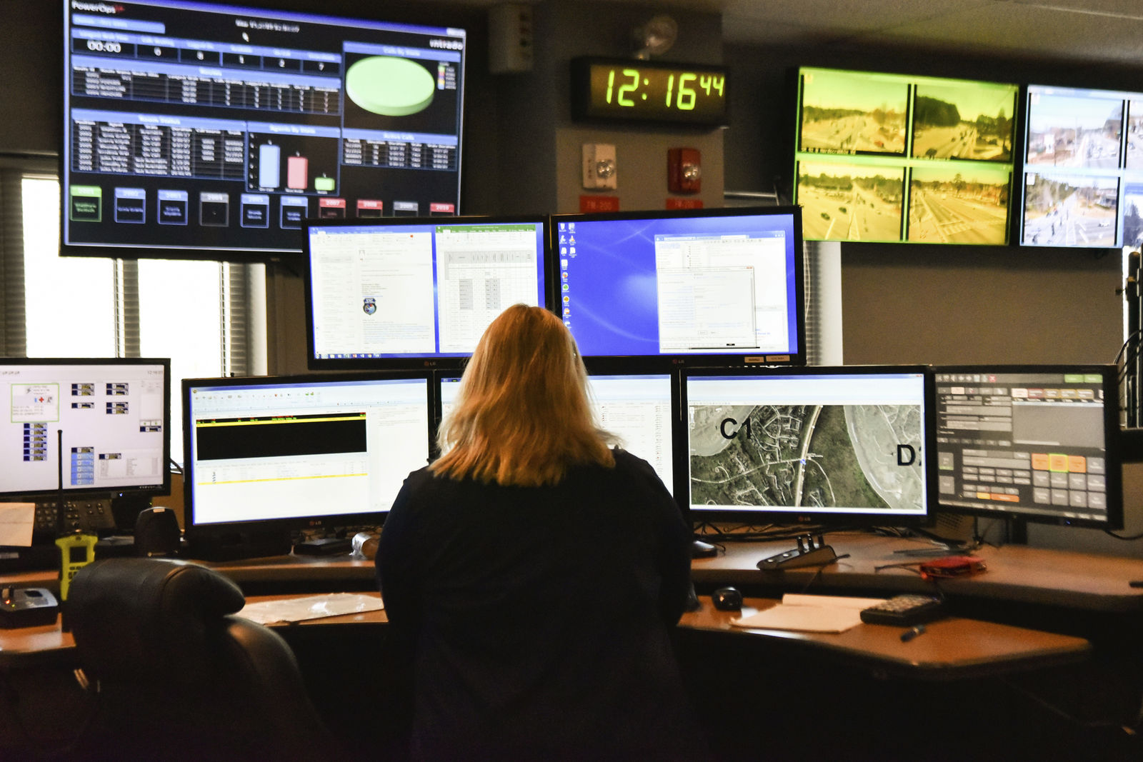 FILE - In this March 15, 2018, file photo, a dispatcher works at a desk station with a variety of screens used by those who take 911 emergency calls. (AP Photo/Lisa Marie Pane, File)
