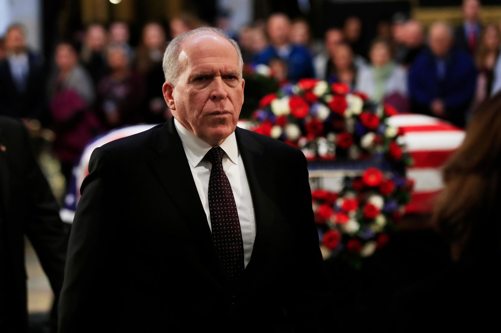 Former CIA Director John Brennan, leaves the Capitol Rotunda after paying his last respects to former President George H.W. Bush as he lies in state at the U.S. Capitol in Washington, Tuesday, Dec. 4, 2018. (AP Photo/Manuel Balce Ceneta)
