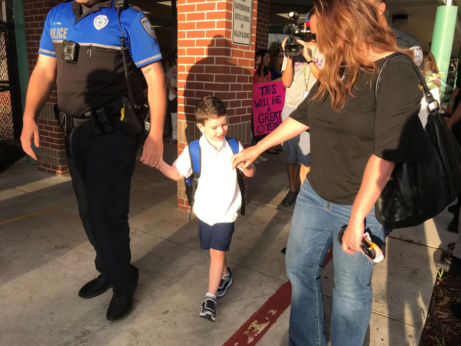 West Palm Beach Police Department surprises son of fallen officer at first day of school. (WPEC)