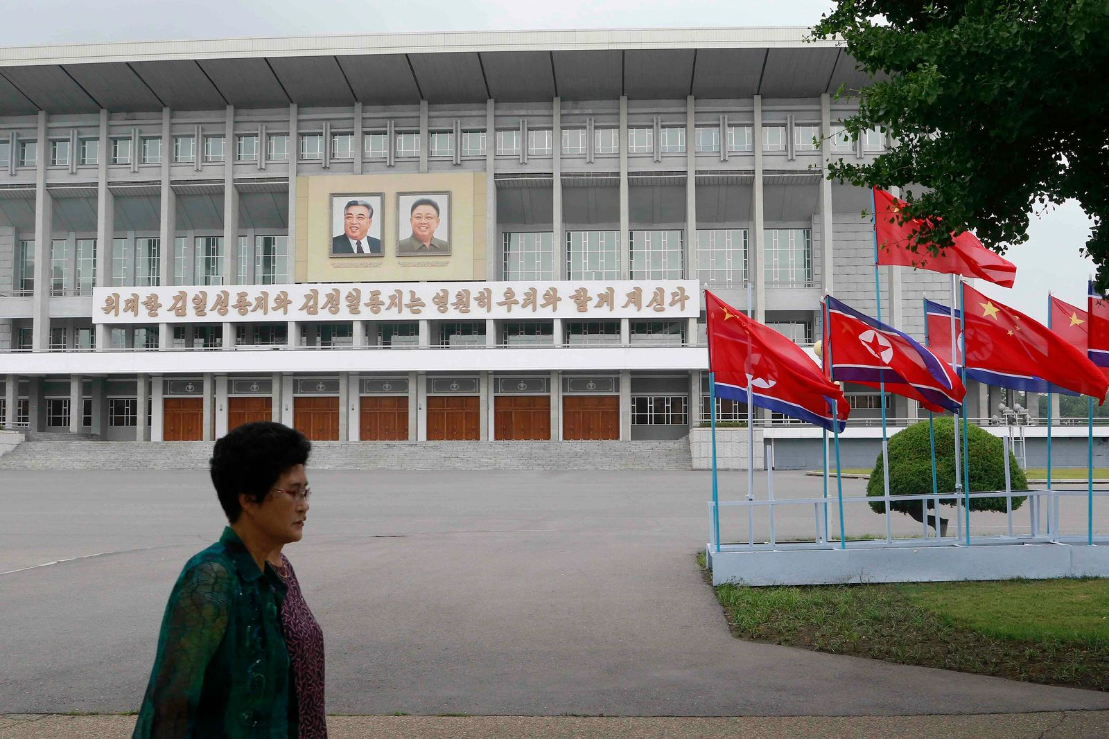 North Korean and Chinese national flags are hoisted on a street in Pyongyang, North Korea Thursday, June 20, 2019. (AP Photo/Jon Chol Jin)