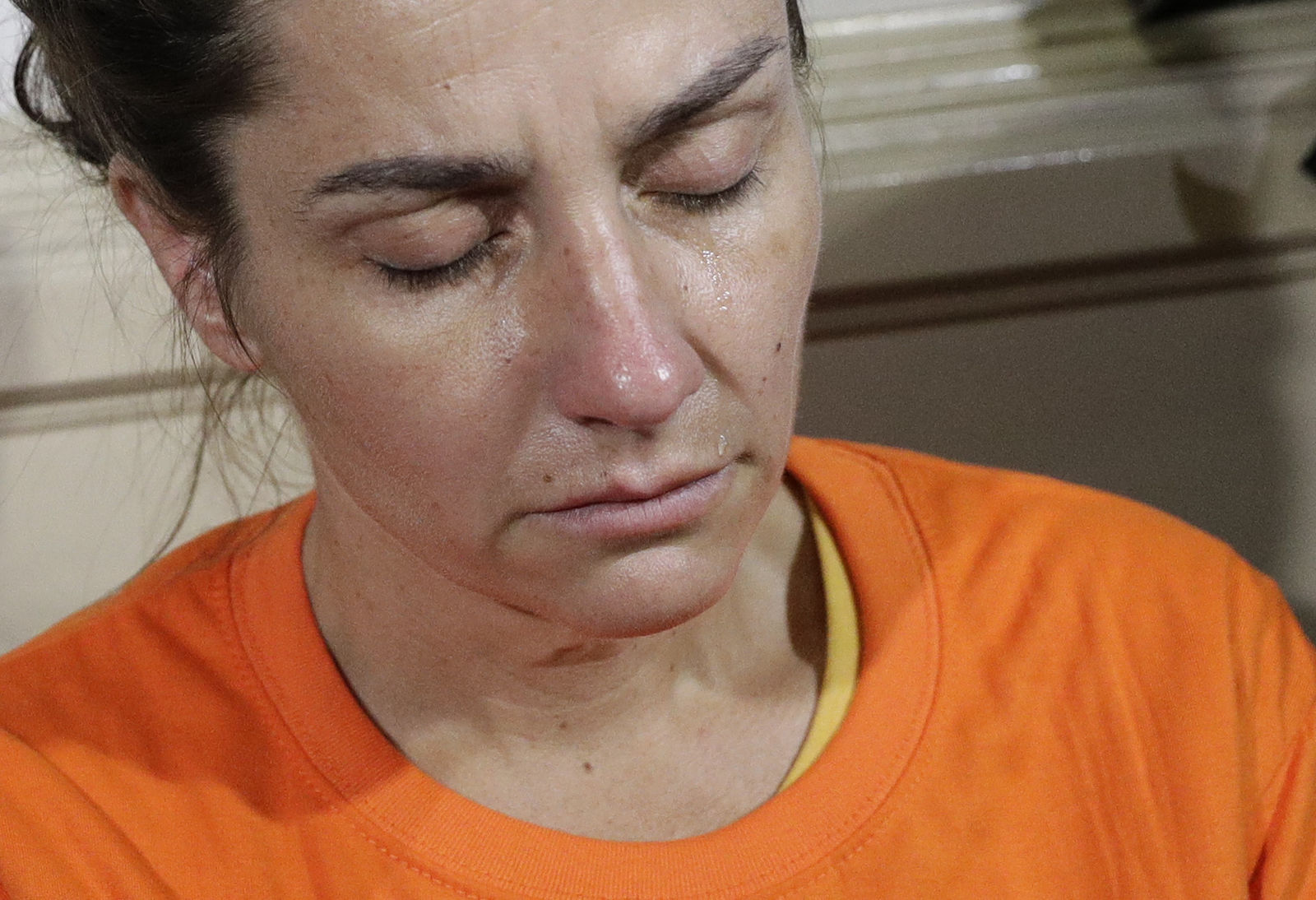 A tear rolls on the cheek of American national Jennifer Erin Talbot from Ohio before the start of a press conference by the National Bureau of Investigation (NBI) in Manila, Philippines, Thursday, Sept. 5, 2019. . (AP Photo/Aaron Favila)