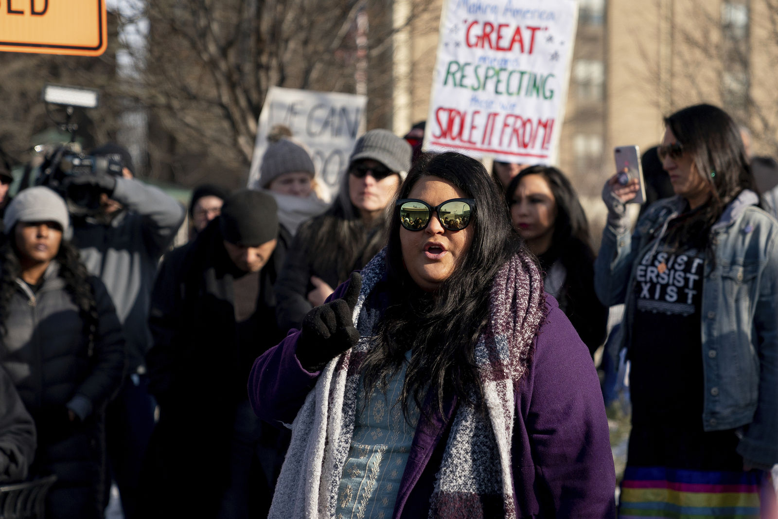 Carolina A. Castoreno-Santana, Executive Director of the American Indian Center of Indiana, speaks during a gathering in support of Native Americans in front of the Catholic Diocese in Covington, Ky., Tuesday, Jan 22, 2019. (AP Photo/Bryan Woolston)