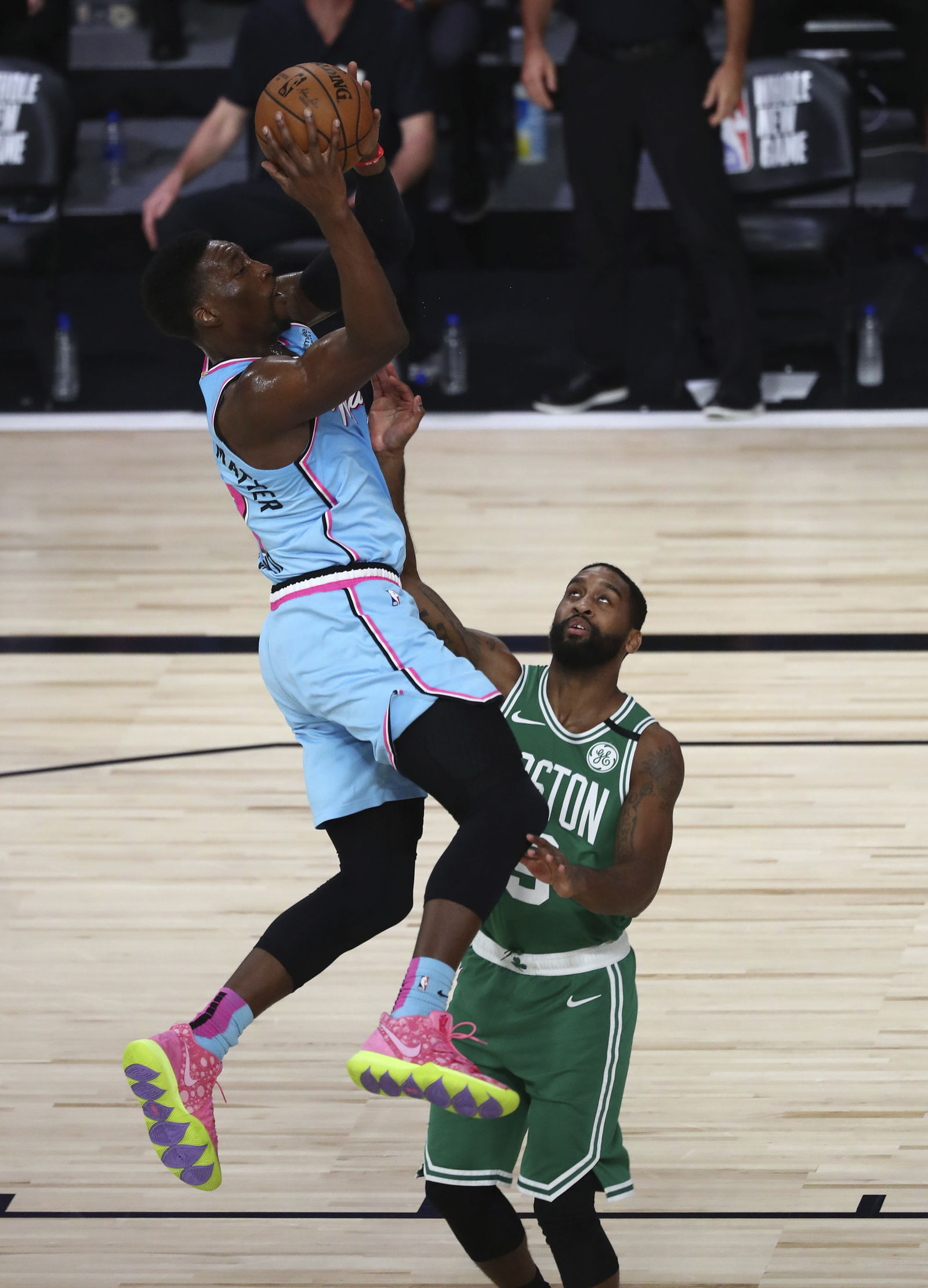 Miami Heat forward Bam Adebayo (13) is fouled as he scores against Boston Celtics guard Brad Wanamaker (9)during the second half of an NBA basketball game Tuesday, Aug. 4, 2020, in Lake Buena Vista, Fla. (Kim Klement/Pool Photo via AP)
