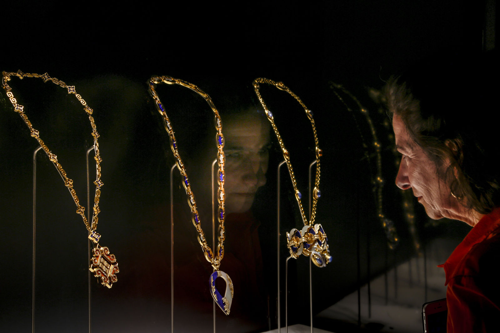 "A woman looks at necklaces on display during a preview of the exhibition ""Bulgari. The story, the dream"" at St. Angel Castle in Rome, Tuesday, June 25, 2019.{ } (AP Photo/Domenico Stinellis)"