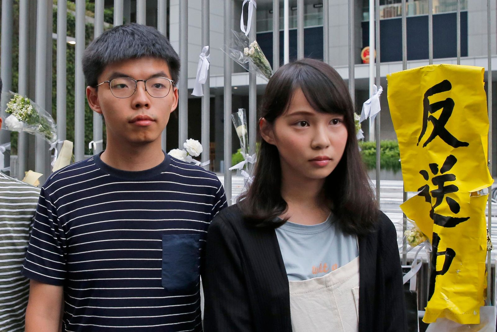 In this June 18, 2019, photo, pro-democracy activists Agnes Chow, right, and Joshua Wong meet media outside government office in Hong Kong.{ } (AP Photo/Kin Cheung)