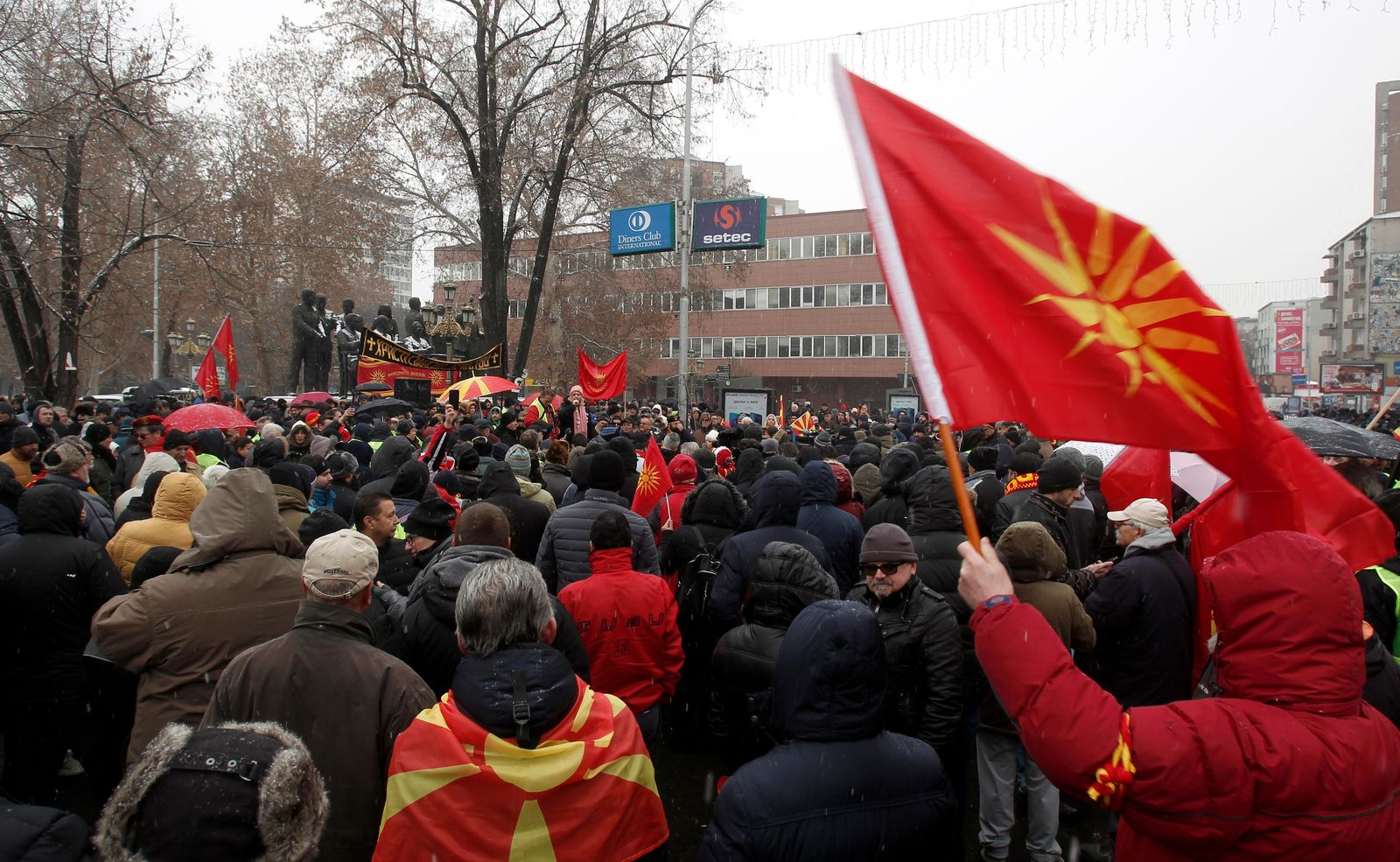 Opponents to the change of the country's constitutional name protest outside the parliament building prior to a session of the Macedonian Parliament in the capital Skopje, Wednesday, Jan. 9, 2019. (AP Photo/Boris Grdanoski)
