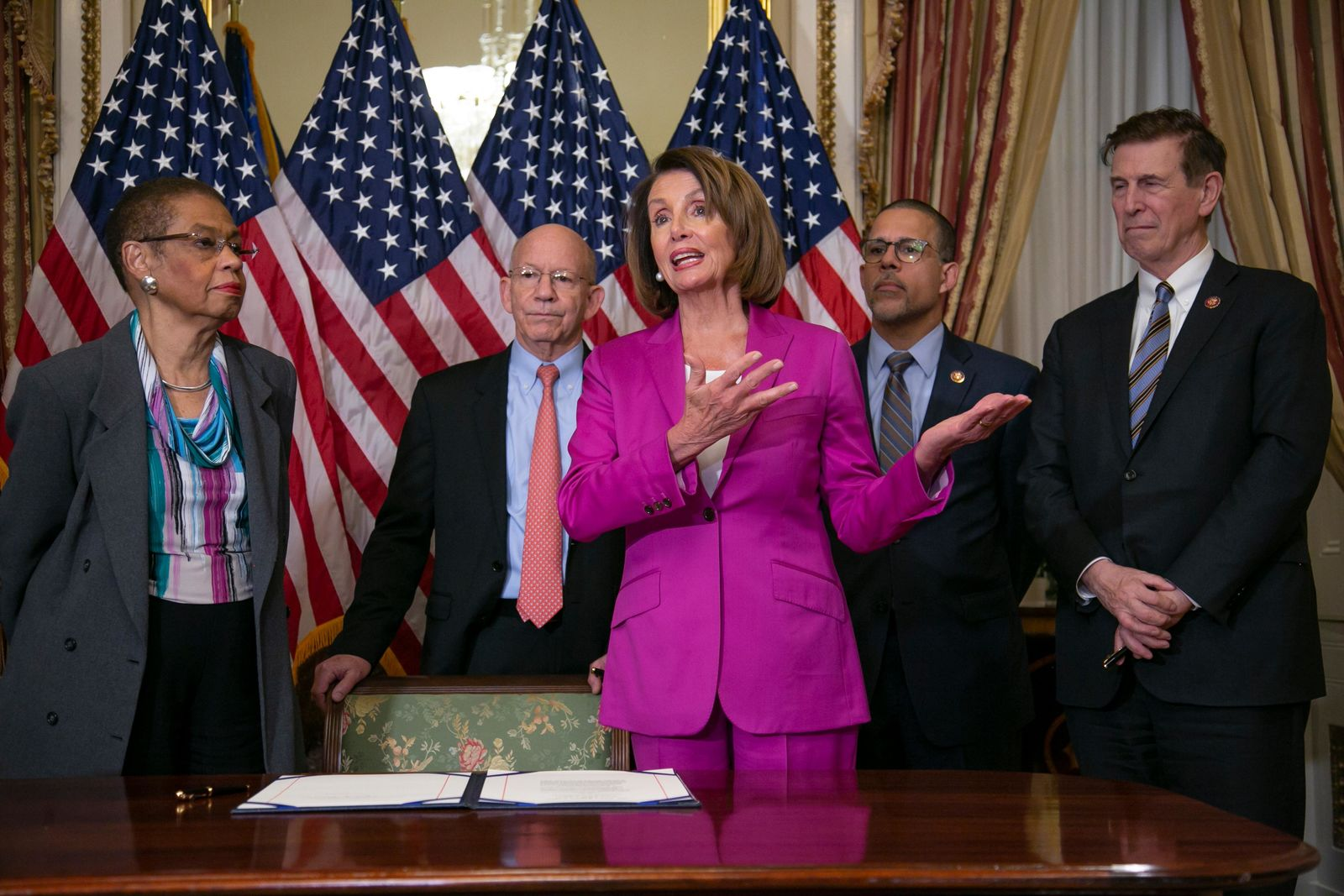Speaker of the House Nancy Pelosi, D-Calif., talks to reporters after signing a House-passed a bill requiring that all government workers receive retroactive pay after the partial shutdown ends, at the Capitol in Washington, Friday, Jan. 11, 2019. (AP Photo/J. Scott Applewhite)