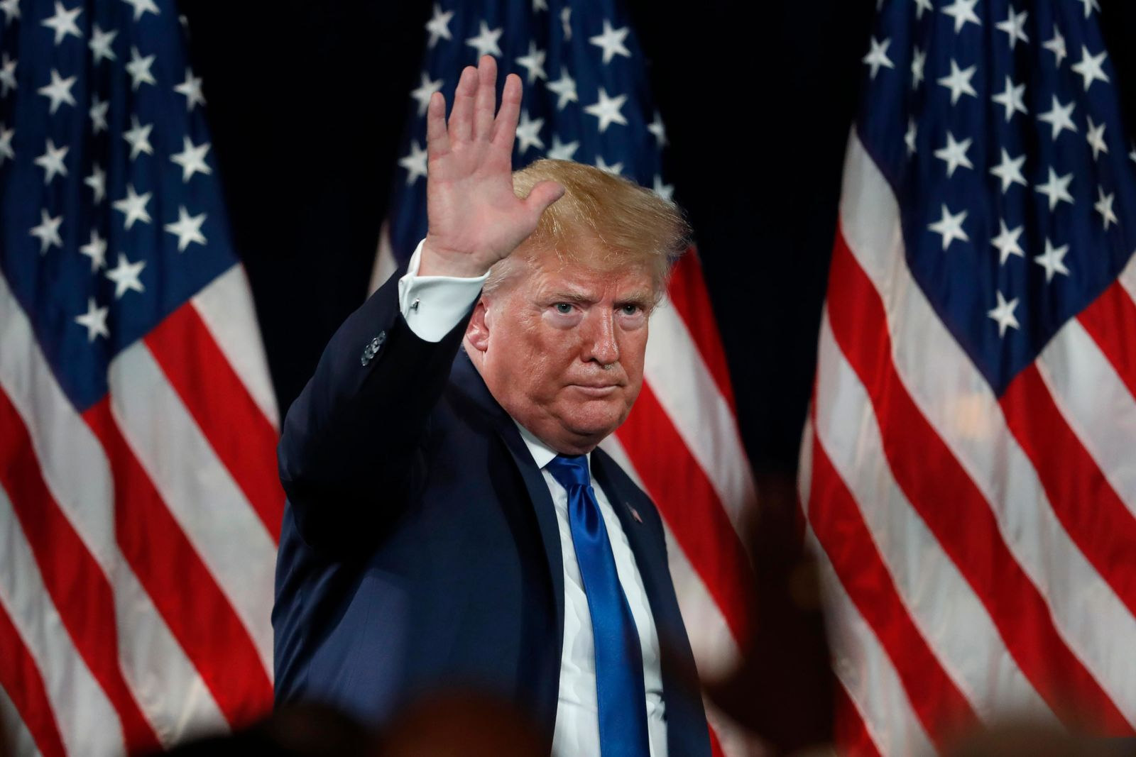 President Donald Trump waves to supporters after speaking at his Black Voices for Trump rally Friday, Nov. 8, 2019, in Atlanta. (AP Photo/John Bazemore)